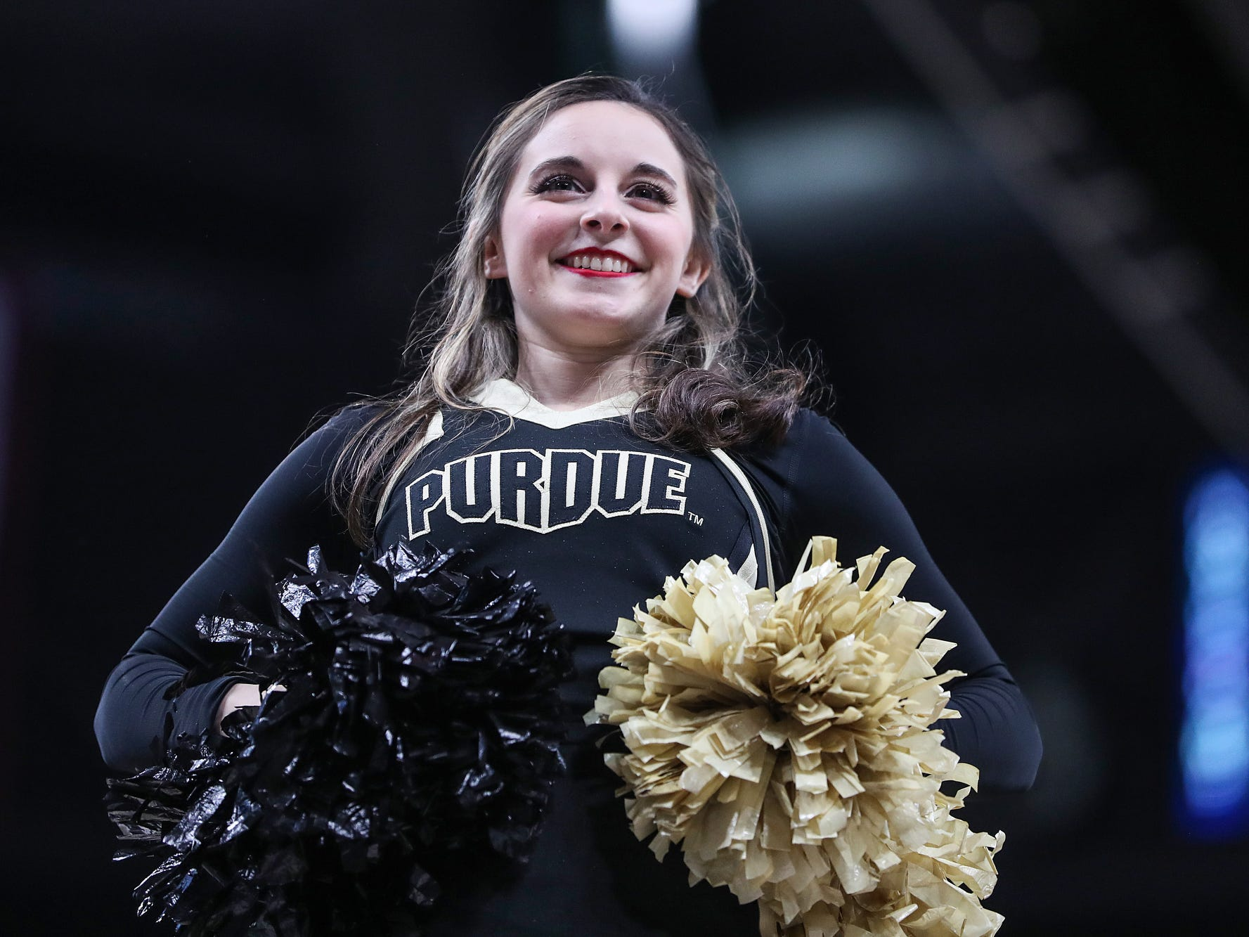 A Purdue Boilermakers cheerleader riles up the crowd in the second half of the Crossroads Classic game between Purdue and Notre Dame at Bankers Life Fieldhouse in Indiananpolis, Saturday, Dec. 15, 2018. Notre Dame won, 88-80.
