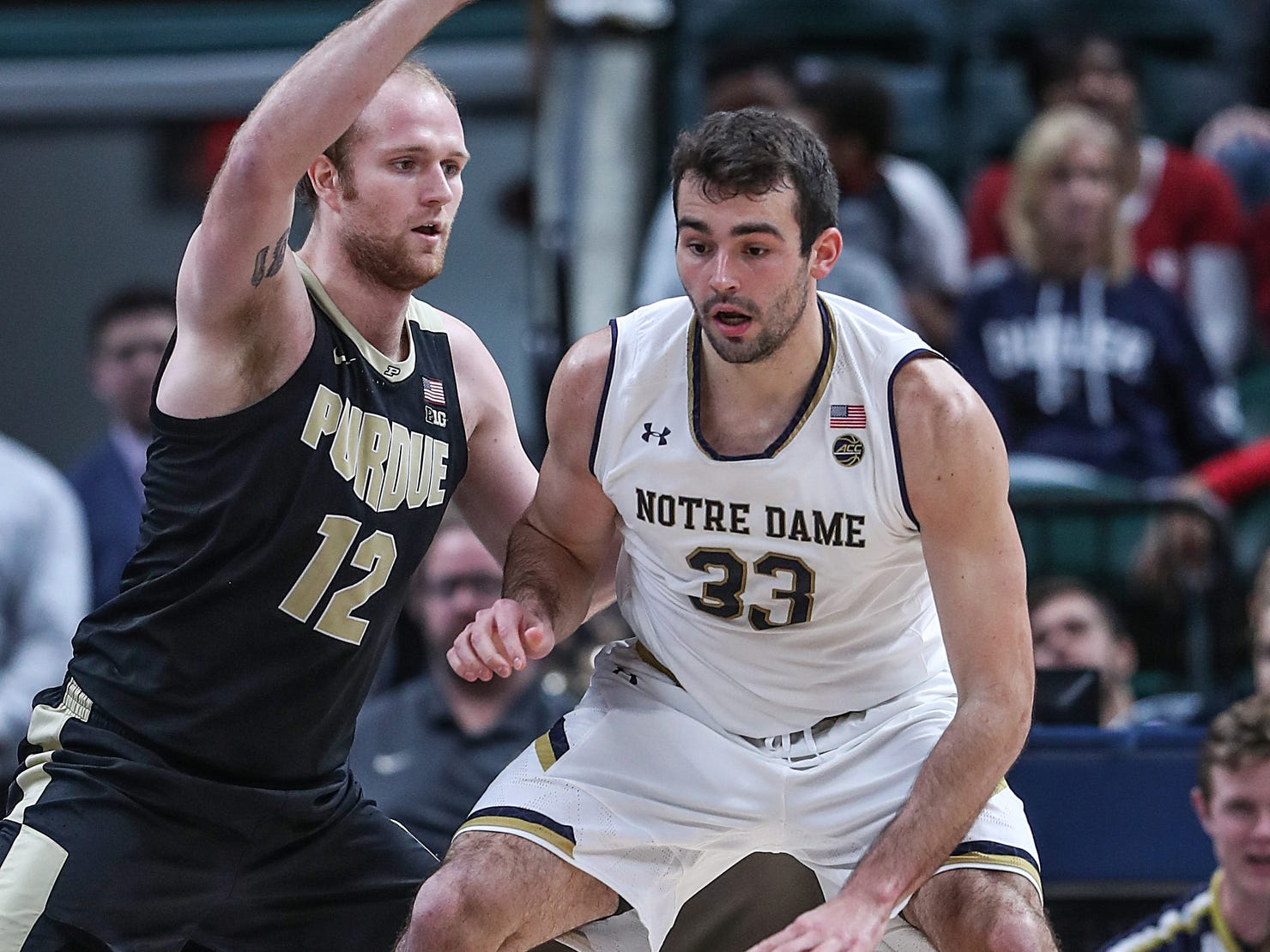 Purdue Boilermakers forward Evan Boudreaux (12) guards Notre Dame Fighting Irish forward John Mooney (33) in the second half of the Crossroads Classic game between Purdue and Notre Dame at Bankers Life Fieldhouse in Indiananpolis, Saturday, Dec. 15, 2018. Notre Dame won, 88-80.