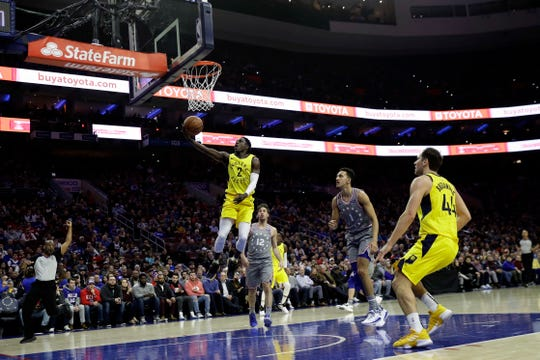 Indiana Pacers' Darren Collison (2) goes up to shoot after being fouled by Philadelphia 76ers' Landry Shamet (1) during the first half of an NBA basketball game, Friday, Dec. 14, 2018, in Philadelphia. (AP Photo/Matt Slocum)
