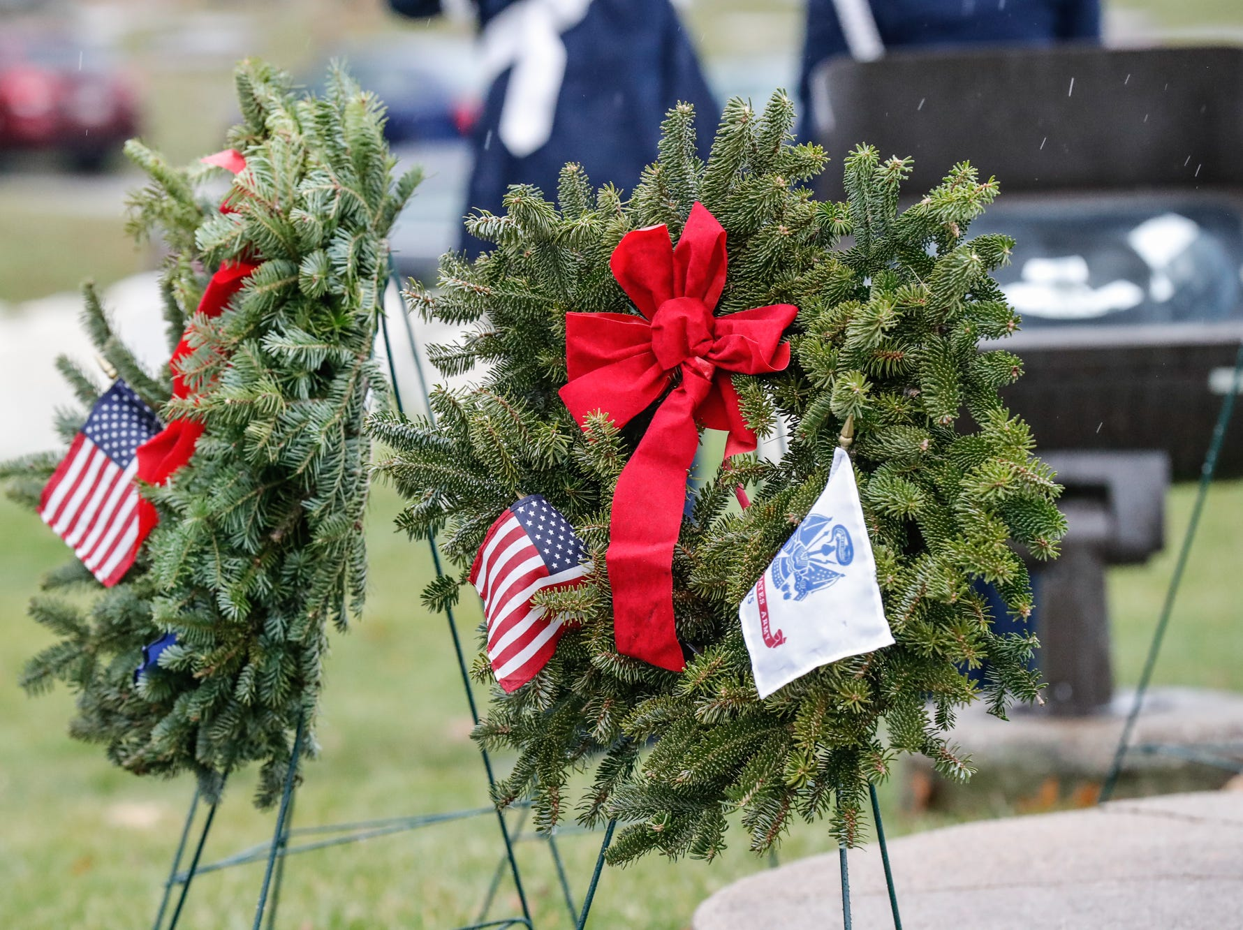 Wreath are laid during the Wreaths Across America wreath laying in remembrance of fallen military heroes at Crown Hill Cemetery on Saturday, Dec. 2018.