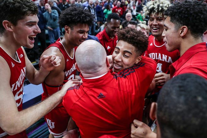 The Indiana Hoosiers celebrate after Rob Phinisee (10), center, hit a three-point shot at the buzzer to defeat Butler in the Crossroads Classic, at Banker's Life Fieldhouse in Indianapolis, Saturday, Dec. 15, 2018. The Hoosiers won, 71-68.