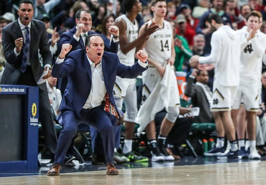 Notre Dame Fighting Irish head coach Mike Brey and teammates go nuts over their lead in the second half of the Crossroads Classic game between Purdue and Notre Dame at Bankers Life Fieldhouse in Indiananpolis, Saturday, Dec. 15, 2018. Notre Dame won, 88-80.
