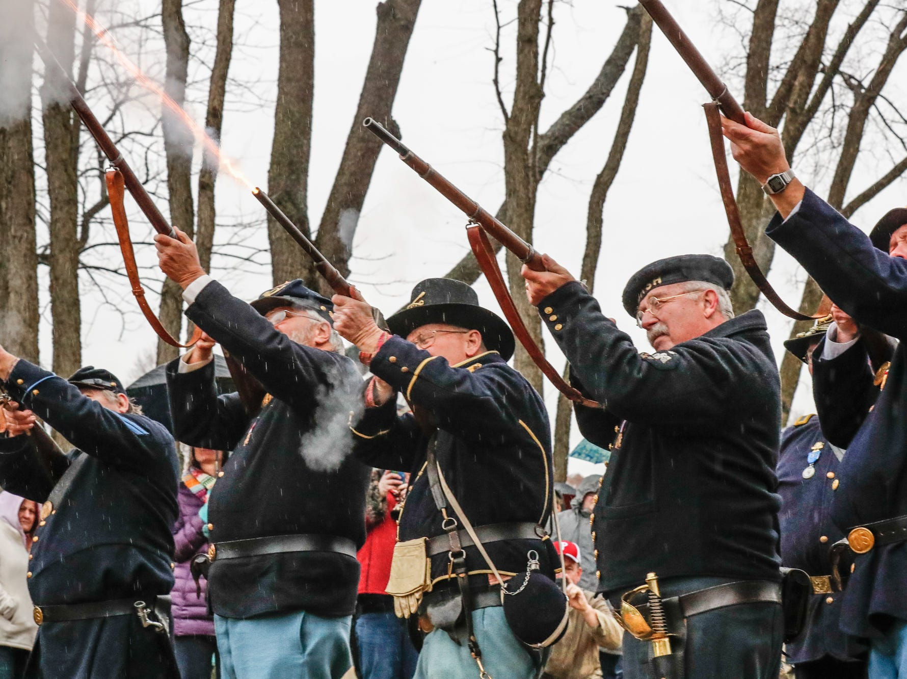 Sons of the Union Veterans of the Civil War perform a twenty one gun salute during the Wreaths Across America wreath laying in remembrance of fallen military heroes at Crown Hill Cemetery on Saturday, Dec. 2018.