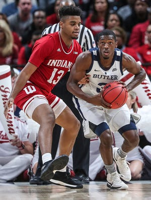Butler Bulldogs guard Kamar Baldwin (3) passes to get the ball away from Indiana Hoosiers forward Juwan Morgan (13) in the first half of the Crossroads Classic game between Butler and IU at Banker's Life Fieldhouse in Indianapolis, Saturday, Dec. 15, 2018.