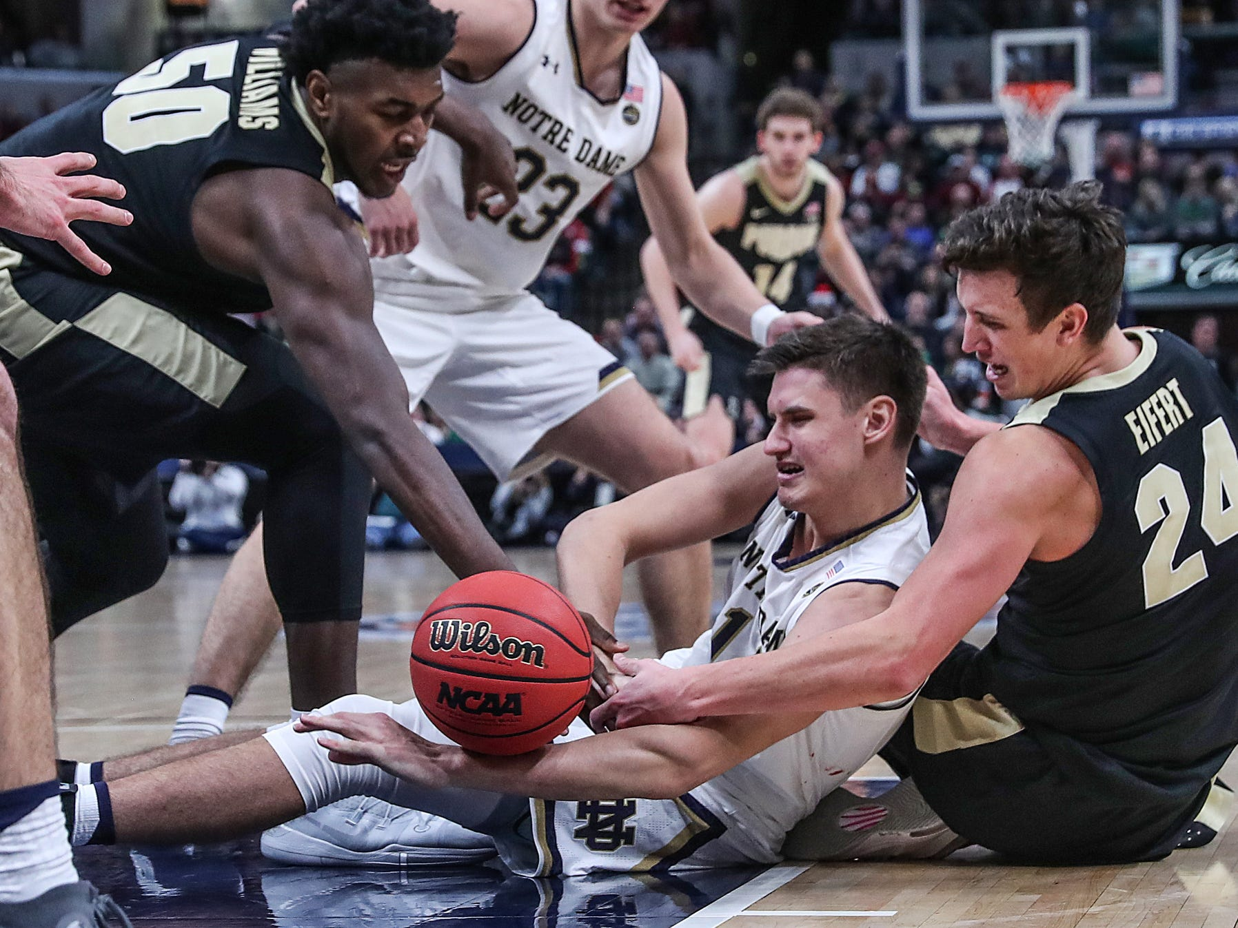 Players grapple over a jumpball in the second half of the Crossroads Classic game between Purdue and Notre Dame at Bankers Life Fieldhouse in Indiananpolis, Saturday, Dec. 15, 2018. Notre Dame won, 88-80.