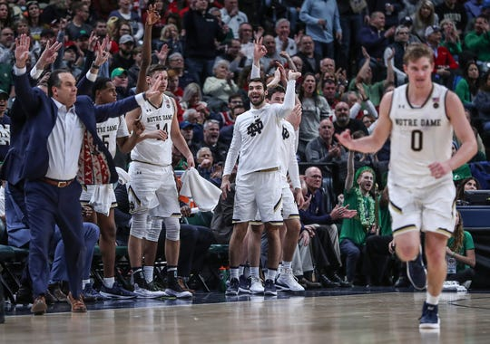 The Notre Dame Fighting Irish celebrate three points scored by guard Dane Goodwin (23) in the second half of the Crossroads Classic game between Purdue and Notre Dame at Bankers Life Fieldhouse in Indiananpolis, Saturday, Dec. 15, 2018. Notre Dame won, 88-80.