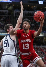 Indiana Hoosiers forward Juwan Morgan (13) shoots a layup past Butler Bulldogs forward Nate Fowler (51) in the first half of the Crossroads Classic game between Butler and IU at Banker's Life Fieldhouse in Indianapolis, Saturday, Dec. 15, 2018.