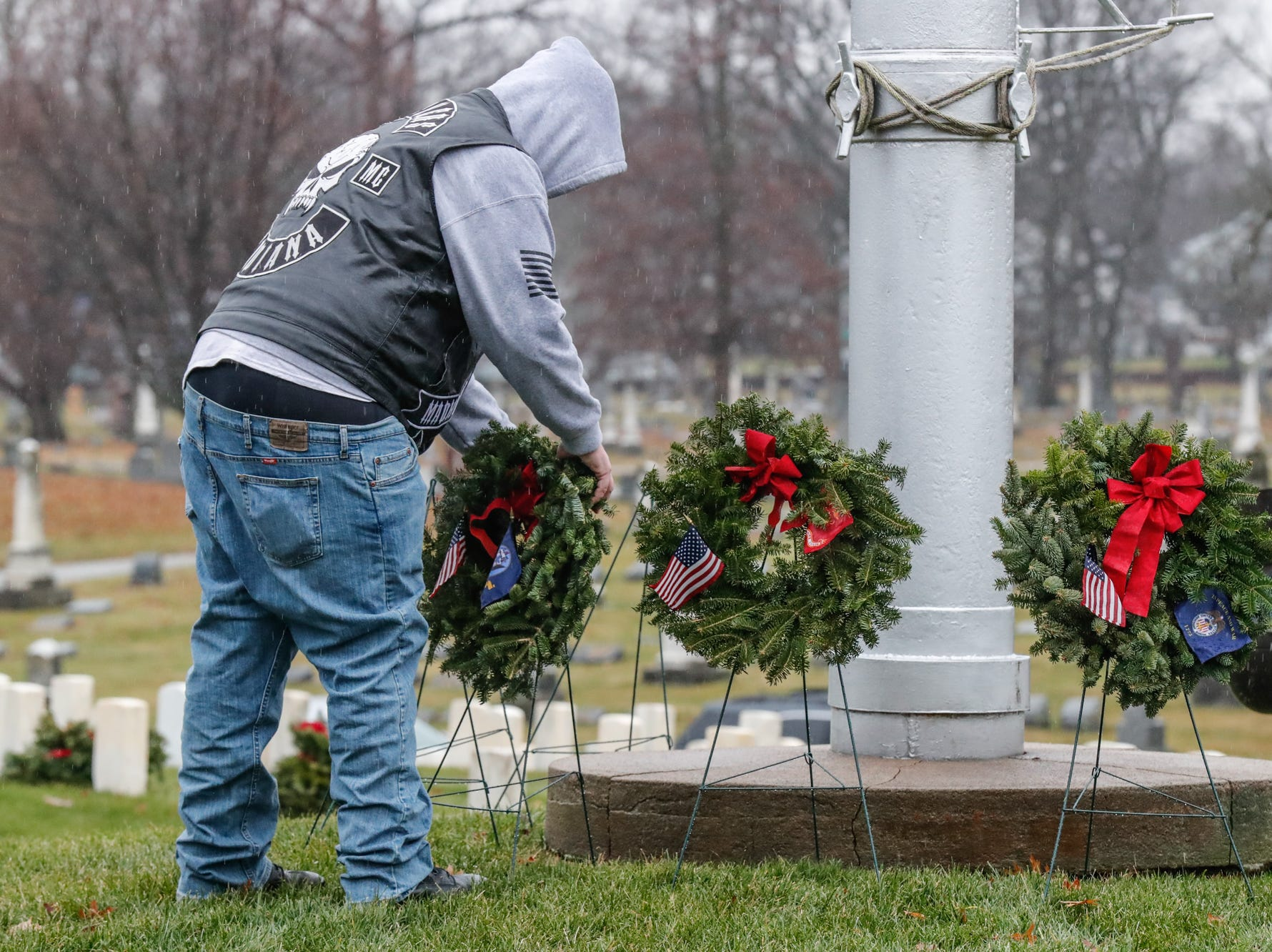 Navy veteran, Michael Goad lays a wreath during the Wreaths Across America wreath laying ceremony in remembrance of fallen military heroes at Crown Hill Cemetery on Saturday, Dec. 2018.