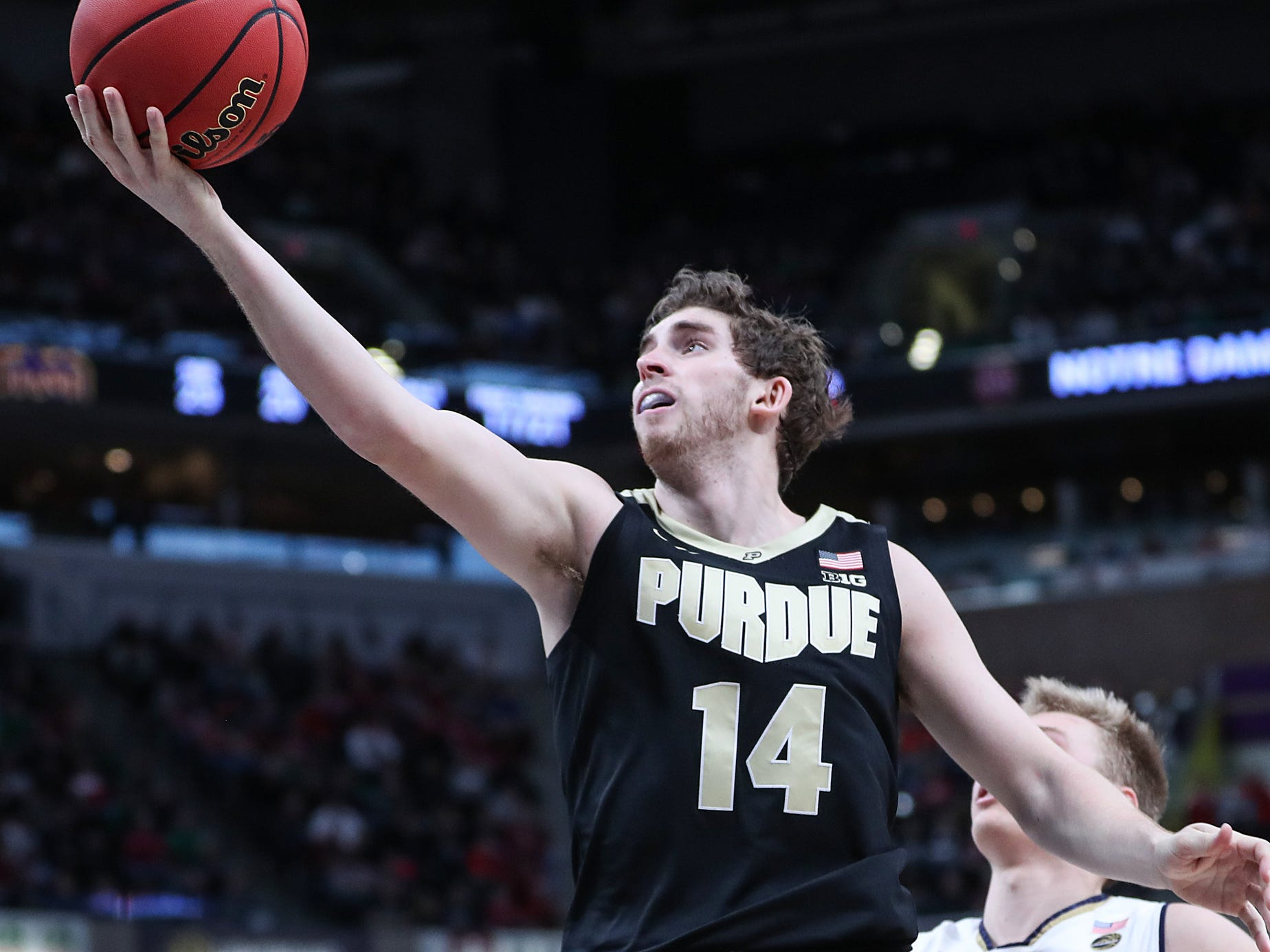 Purdue Boilermakers guard Ryan Cline (14) takes the ball to the hoop in the second half of the Crossroads Classic game between Purdue and Notre Dame at Bankers Life Fieldhouse in Indiananpolis, Saturday, Dec. 15, 2018. Notre Dame won, 88-80.