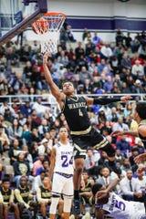 Warren Central's Manuel Brown Jr. (4) scores a basket against Ben Davis.