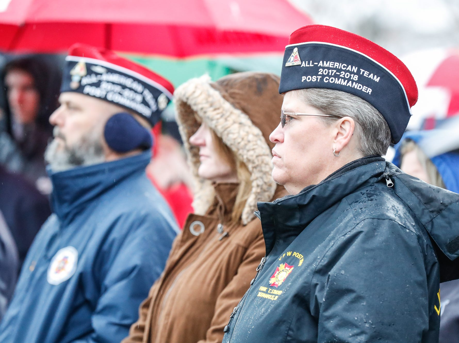Guests listen to speakers during the Wreaths Across America wreath laying in remembrance of fallen military heroes at Crown Hill Cemetery on Saturday, Dec. 2018.