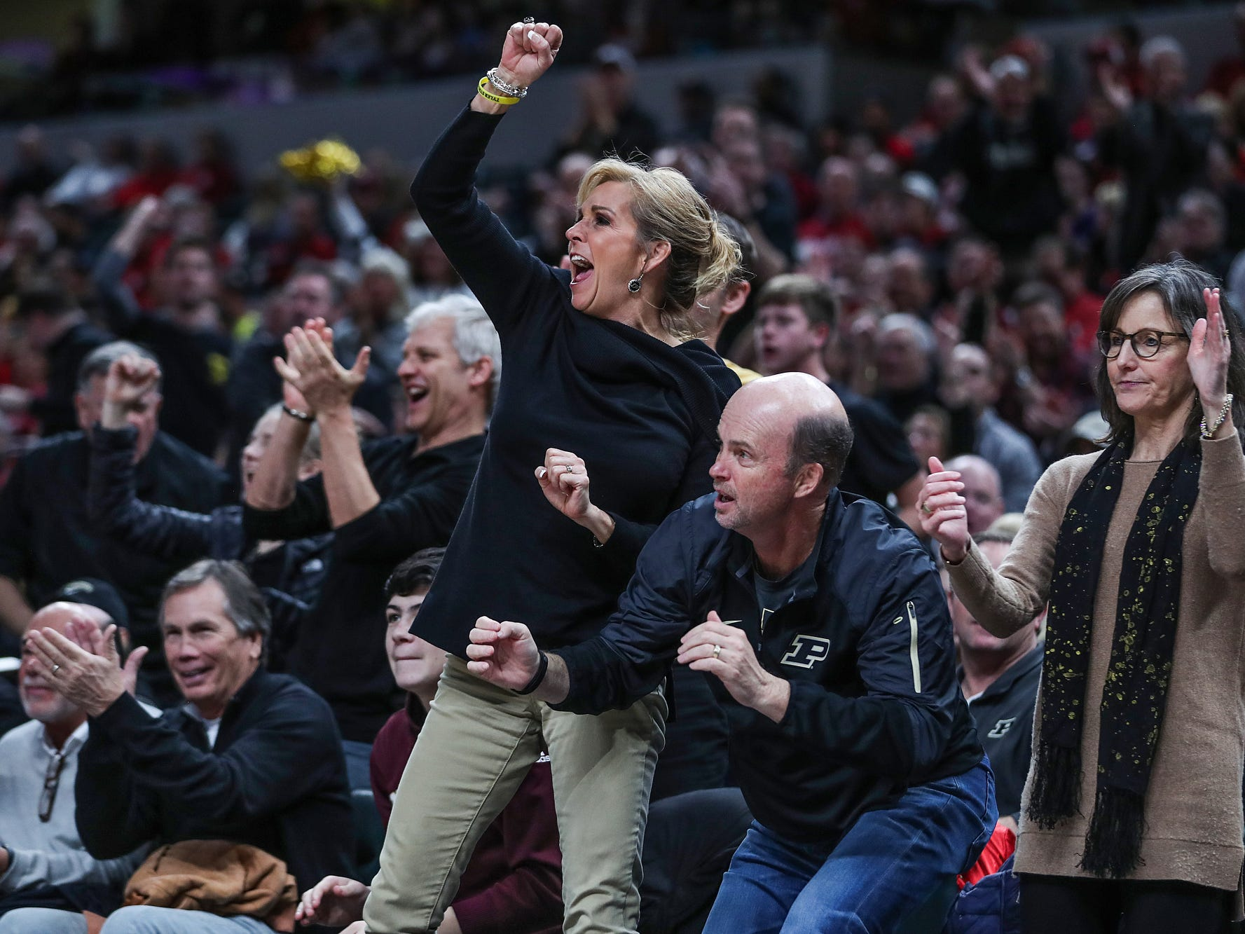 Purdue Boilermakers fans cheer as their team regains possession of the ball in the second half of the Crossroads Classic game between Purdue and Notre Dame at Bankers Life Fieldhouse in Indiananpolis, Saturday, Dec. 15, 2018. Notre Dame won, 88-80.