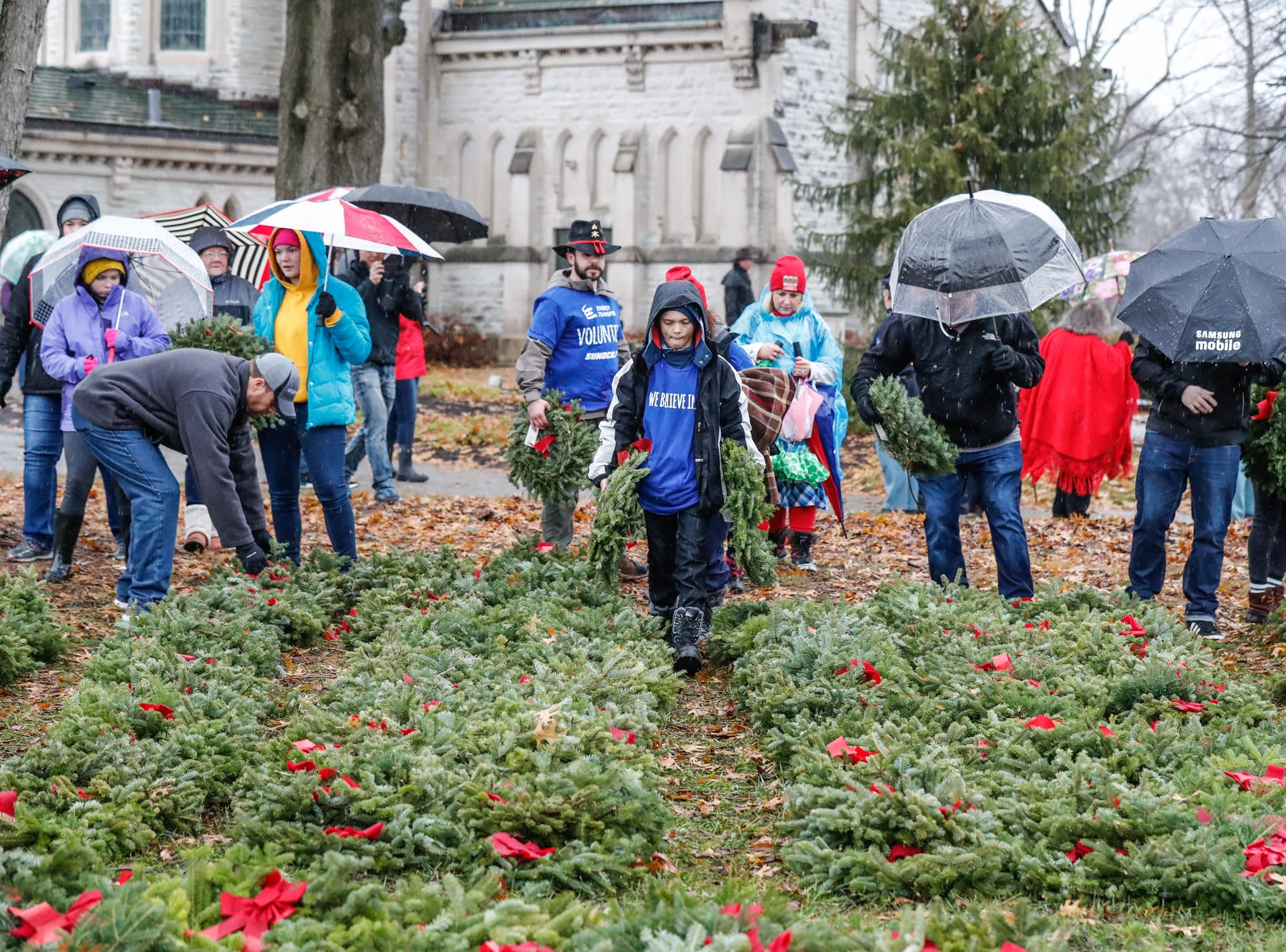 Military veterans, active duty members, and volunteers take part in the  Wreaths Across America wreath laying in remembrance of fallen military heroes at Crown Hill Cemetery on Saturday, Dec. 2018.