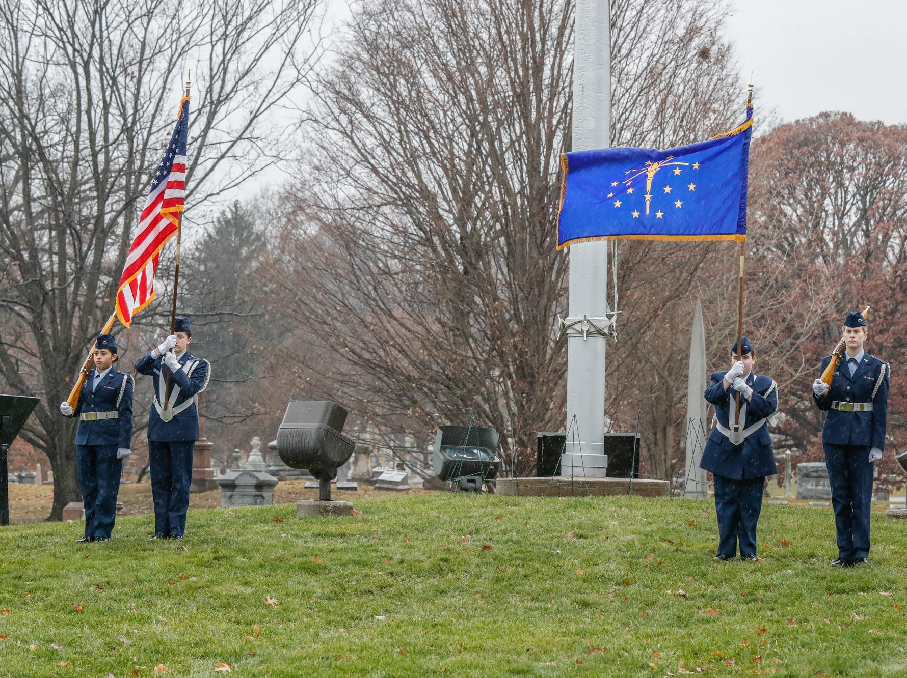 The Titan Cadet Squadron performs the Presentation of Colors during the Wreaths Across America wreath laying in remembrance of fallen military heroes at Crown Hill Cemetery on Saturday, Dec. 2018.