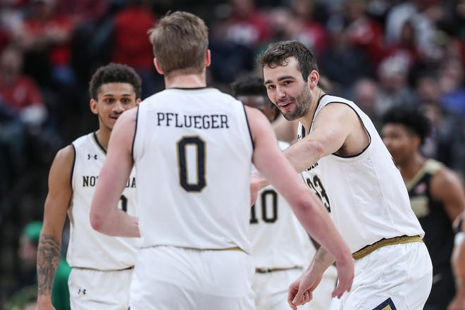 The Notre Dame Fighting Irish celebrate an offensive play in the second half of the Crossroads Classic game between Purdue and Notre Dame at Bankers Life Fieldhouse in Indiananpolis, Saturday, Dec. 15, 2018. Notre Dame won, 88-80.