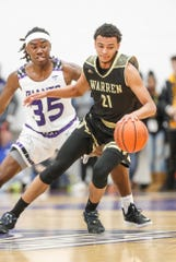 Warren Central's Jamisen Smith (21) looks for space against Ben Davis on Friday night.