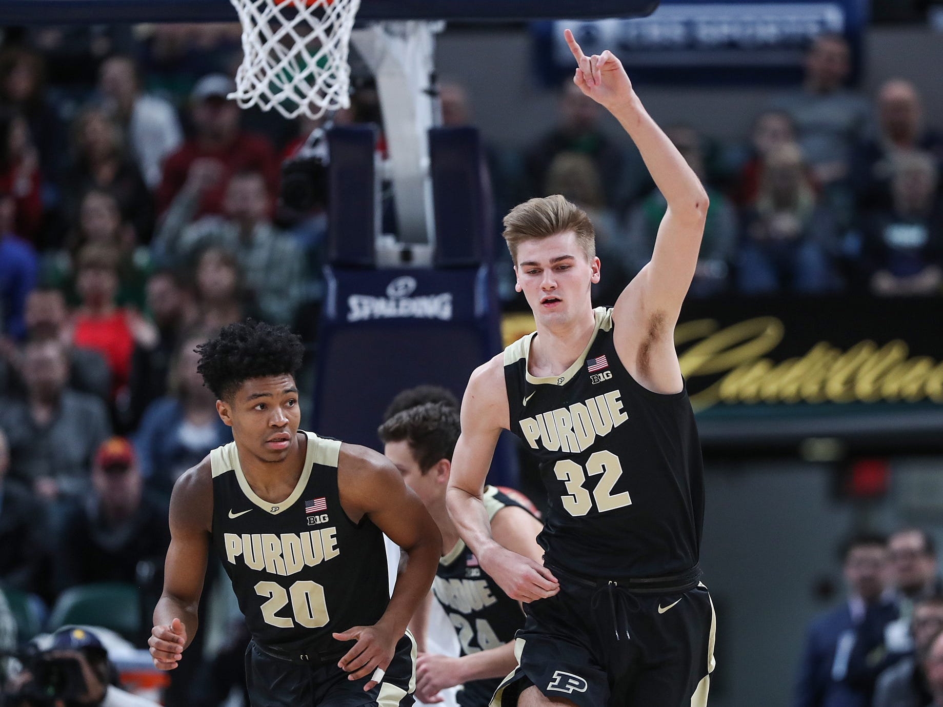 Purdue Boilermakers center Matt Haarms (32) celebrates as Purdue scores the first points of the Crossroads Classic game between Purdue and Notre Dame at Banker's Life Fieldhouse in Indianapolis, Saturday, Dec. 15, 2018.