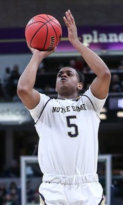 Notre Dame Fighting Irish guard D.J. Harvey (5) shoots in the first half of the Crossroads Classic game between Purdue and Notre Dame at Banker's Life Fieldhouse in Indianapolis, Saturday, Dec. 15, 2018.