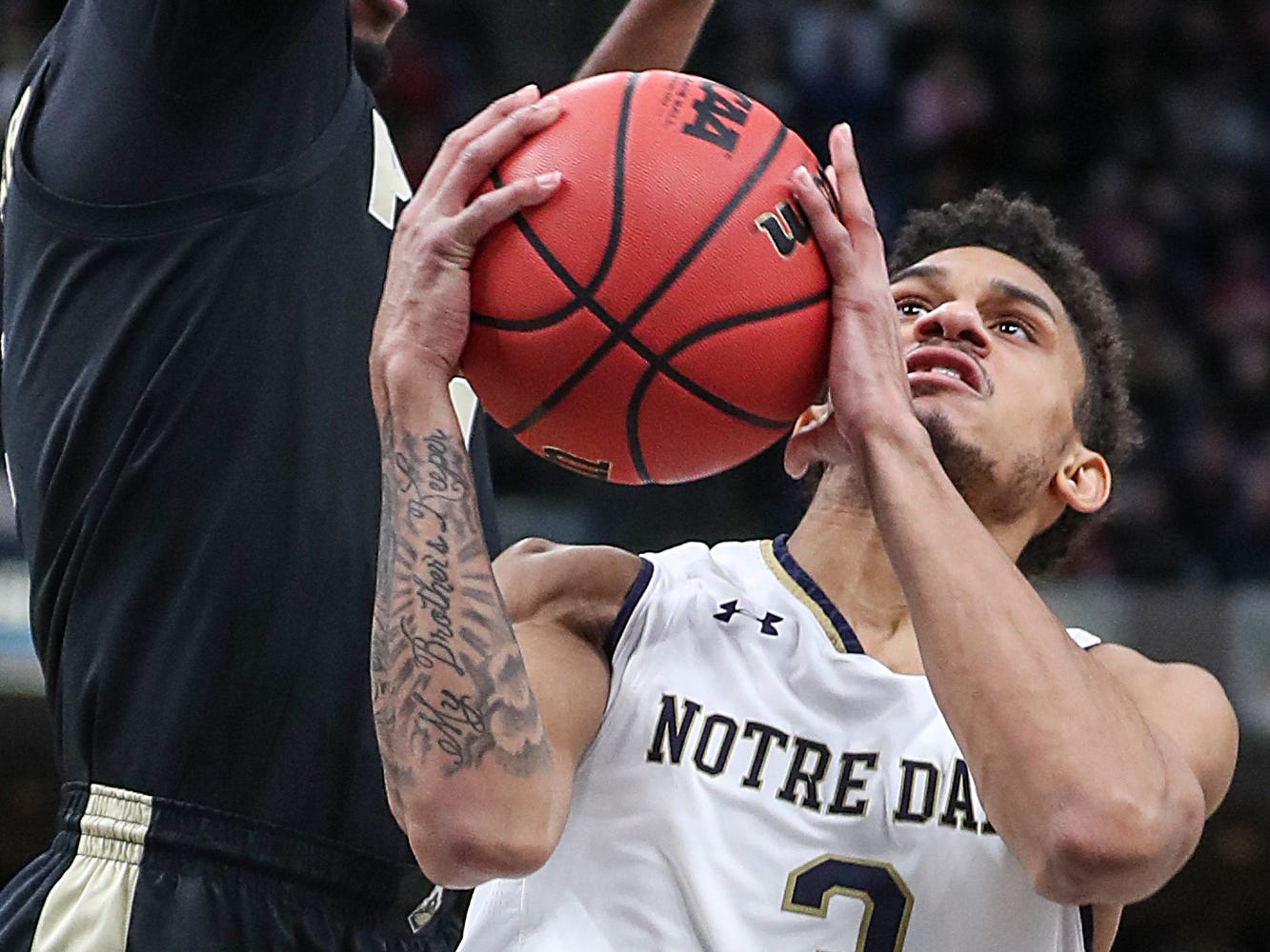 Notre Dame Fighting Irish guard Prentiss Hubb (3) goes for a layup  in the first half of the Crossroads Classic game between Purdue and Notre Dame at Banker's Life Fieldhouse in Indianapolis, Saturday, Dec. 15, 2018.
