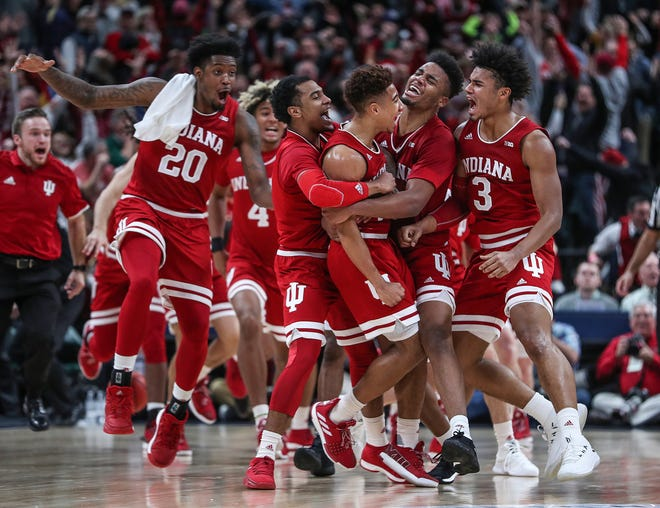 The Indiana Hoosiers celebrate after Rob Phinisee (10) hit a three-point shot at the buzzer to defeat Butler in the Crossroads Classic, at Banker's Life Fieldhouse in Indianapolis, Saturday, Dec. 15, 2018. The Hoosiers won, 71-68.