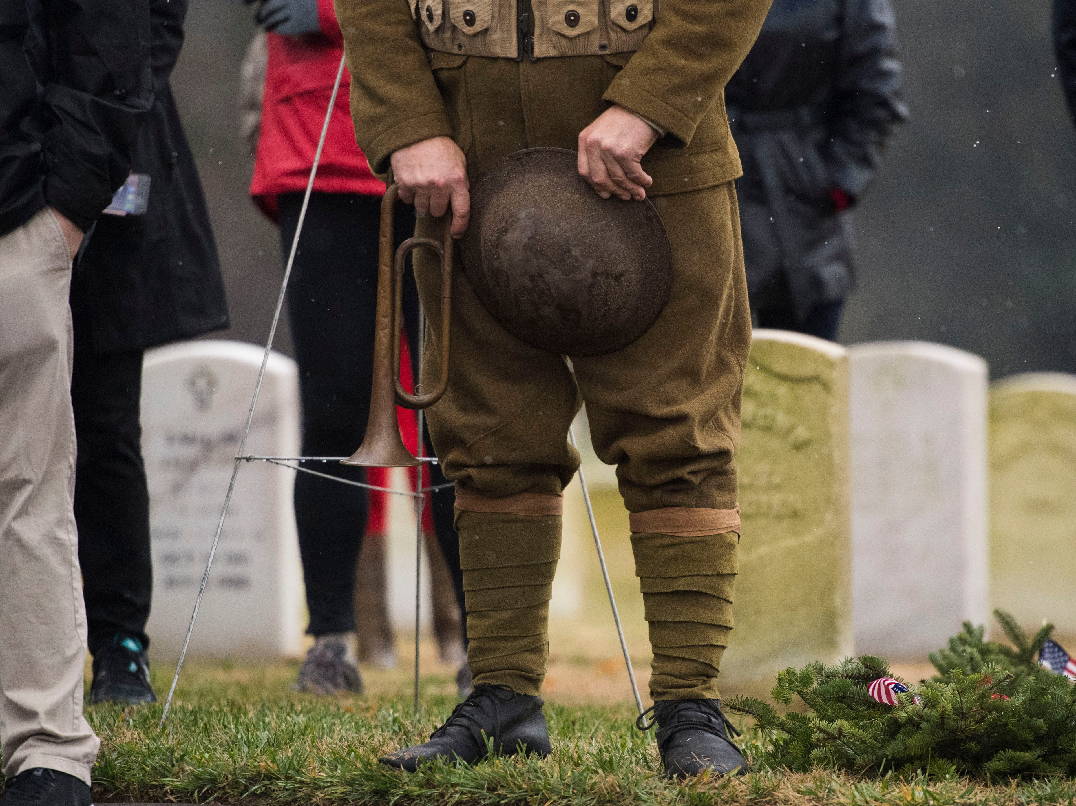 Reenactor William Beard holds his hat and horn during a Wreaths Across America ceremony at Knoxville National Cemetery north of downtown Knoxville Saturday, Dec. 15, 2018. Evergreen wreaths were placed on veteran headstones.