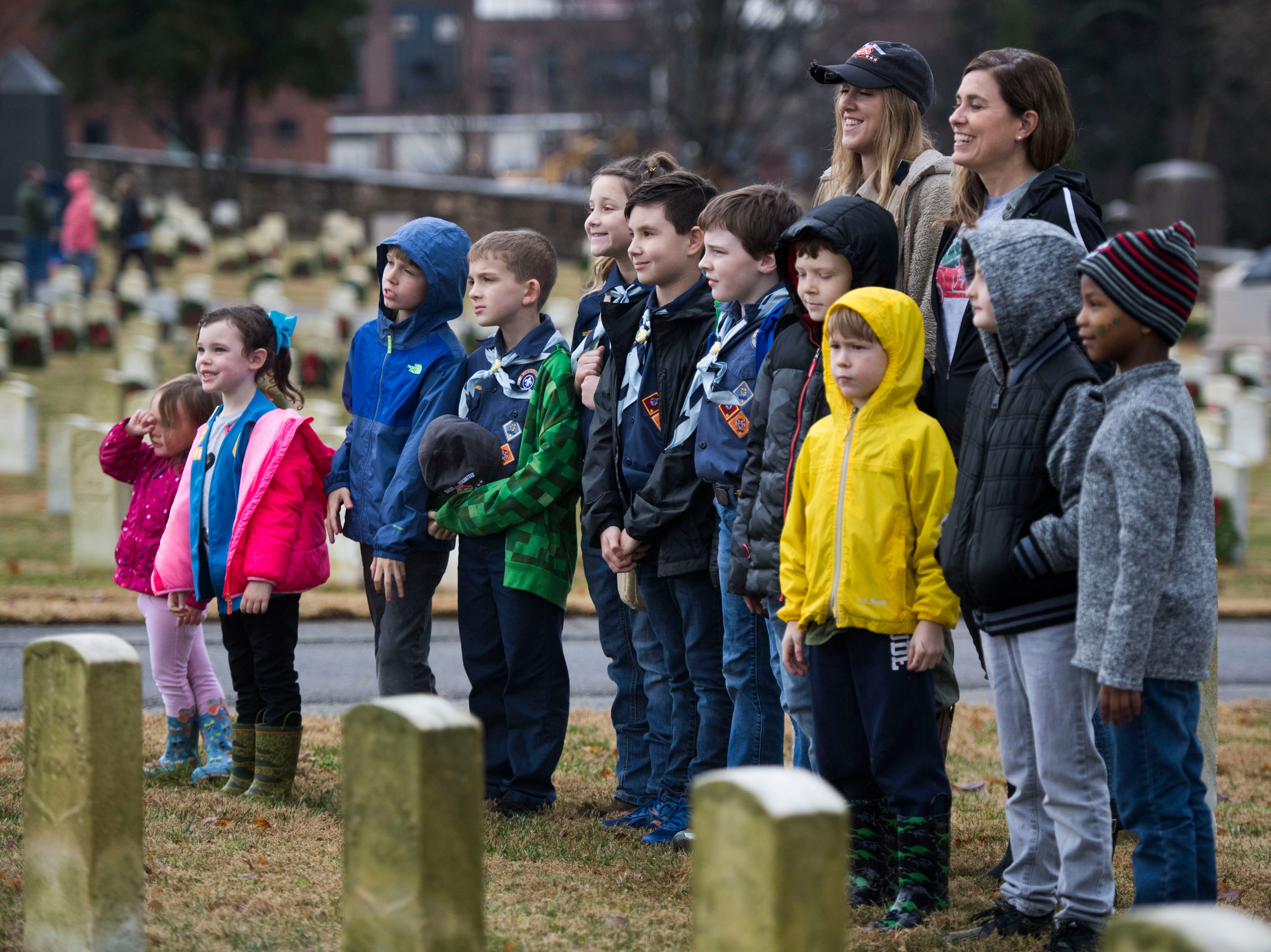 Scouts pose for a photo during a Wreaths Across America ceremony at Knoxville National Cemetery north of downtown Knoxville Saturday, Dec. 15, 2018. Evergreen wreaths were placed on veteran headstones.