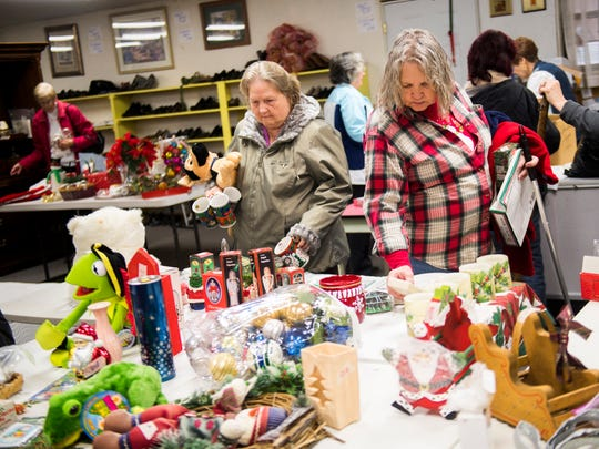 Customers browse through Christmas items at the Morgan-Scott Project's thrift store in Deer Lodge, Tennessee, on Dec. 14.
