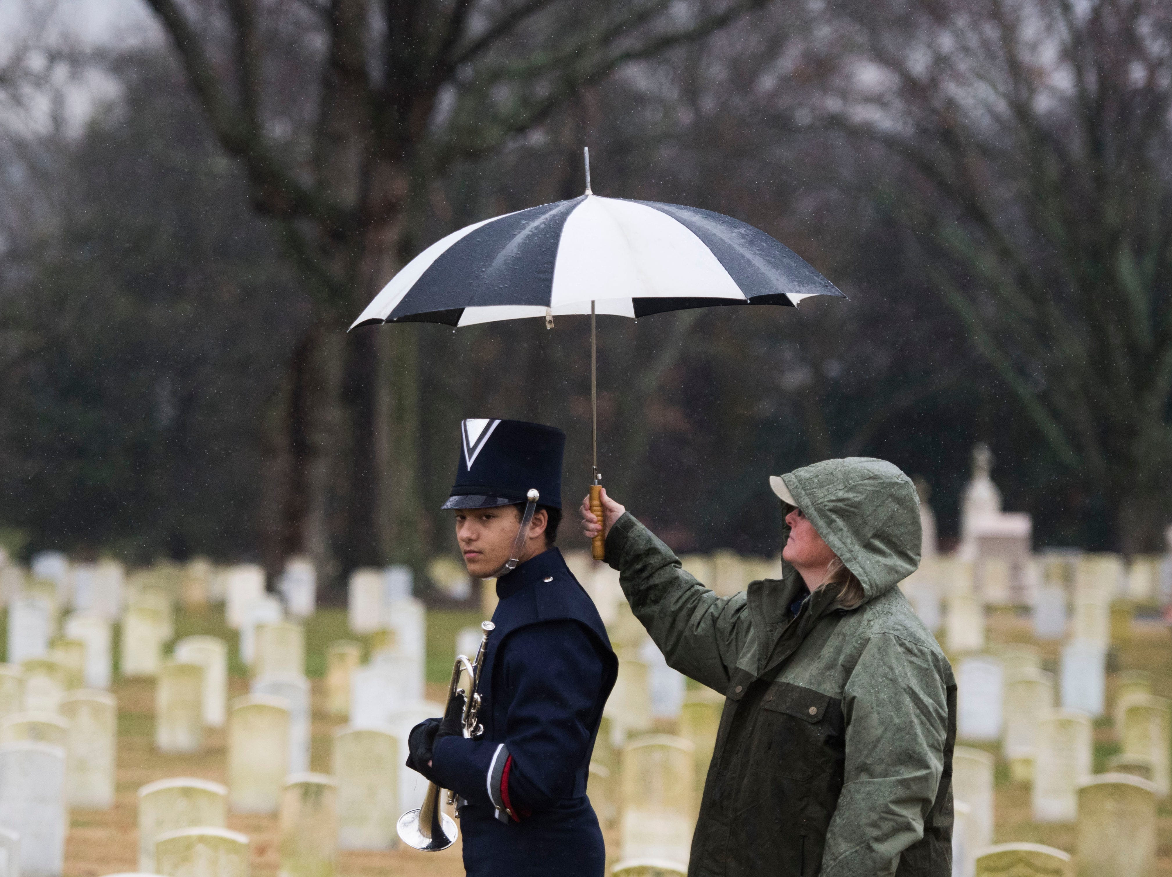 Dylan Desaulniers of South-Doyle high school waits to play taps during a Wreaths Across America ceremony at Knoxville National Cemetery north of downtown Knoxville Saturday, Dec. 15, 2018. Evergreen wreaths were placed on veteran headstones.