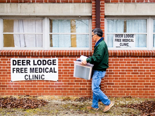 Dr. Tom Kim carries out items before closing down his free medical clinic in Deer Lodge on Dec. 14.