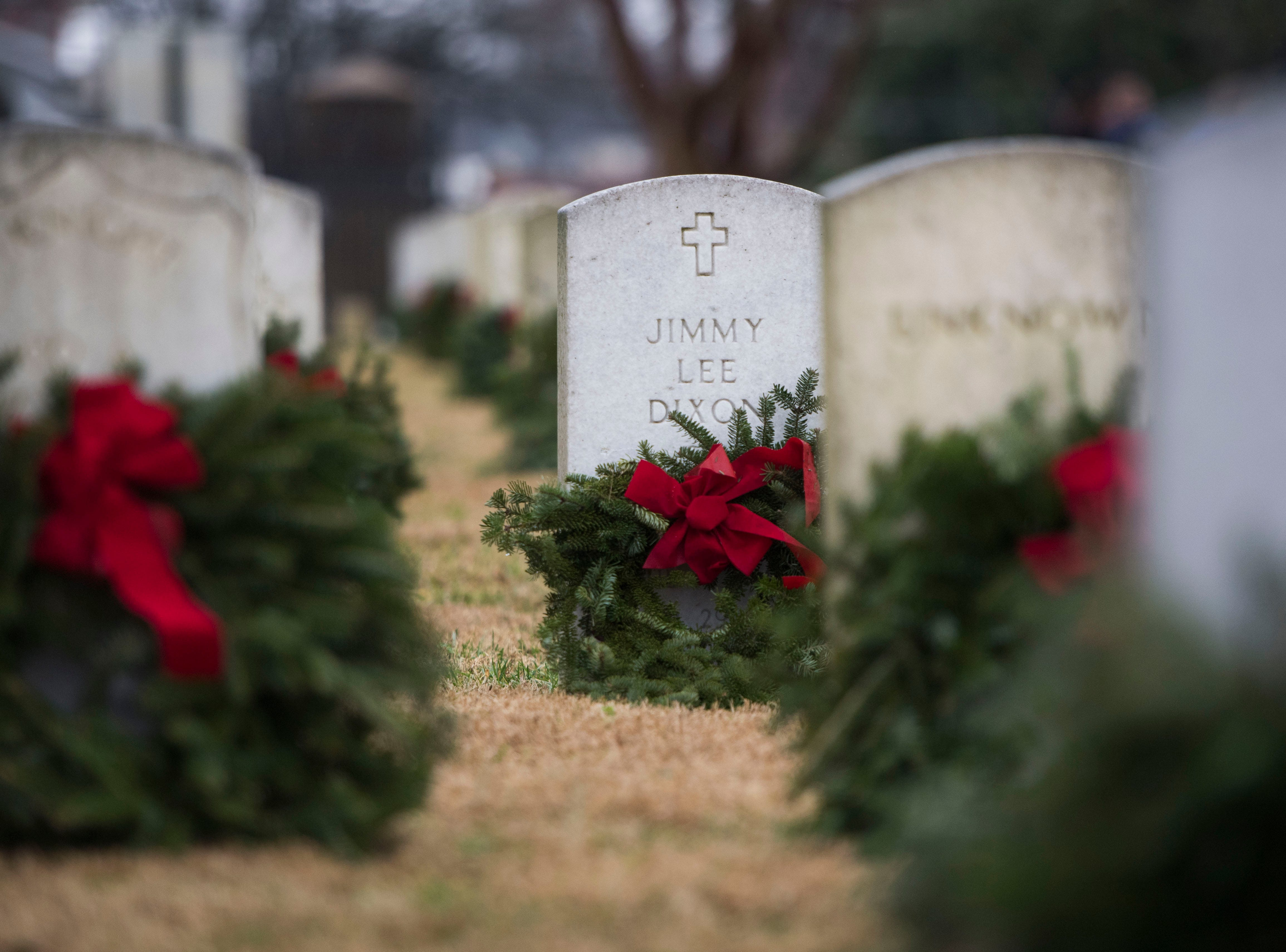 Wreaths lay on headstones during a Wreaths Across America ceremony at Knoxville National Cemetery north of downtown Knoxville Saturday, Dec. 15, 2018.