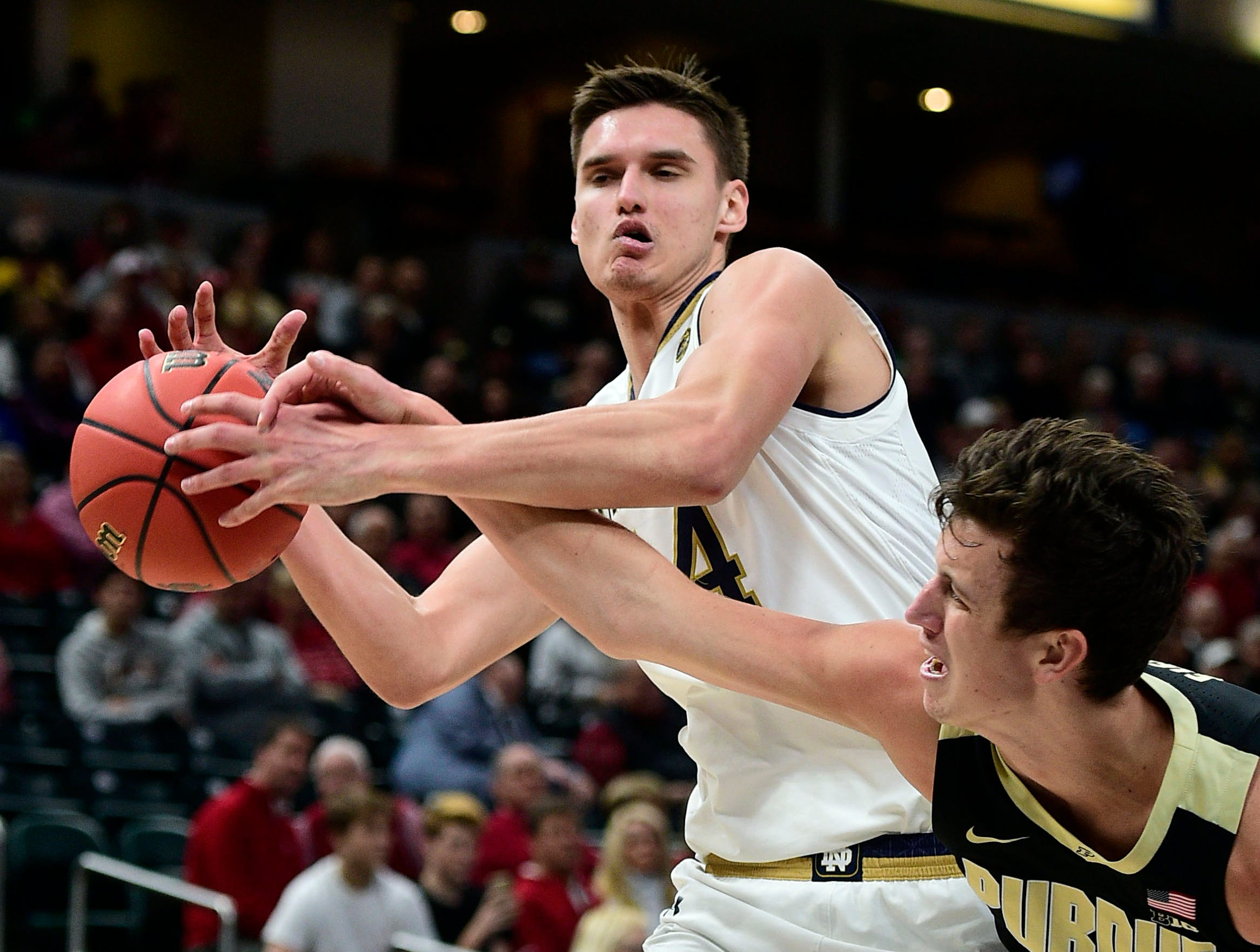 Dec 15, 2018; Indianapolis, IN, USA; Purdue Boilermaker guards Grady Eifert (24) goes after a rebound in the first half against Notre Dame Fighting Irish forward Nate Laszewski (14) at Bankers Life Fieldhouse. Mandatory Credit: Thomas J. Russo-USA TODAY Sports