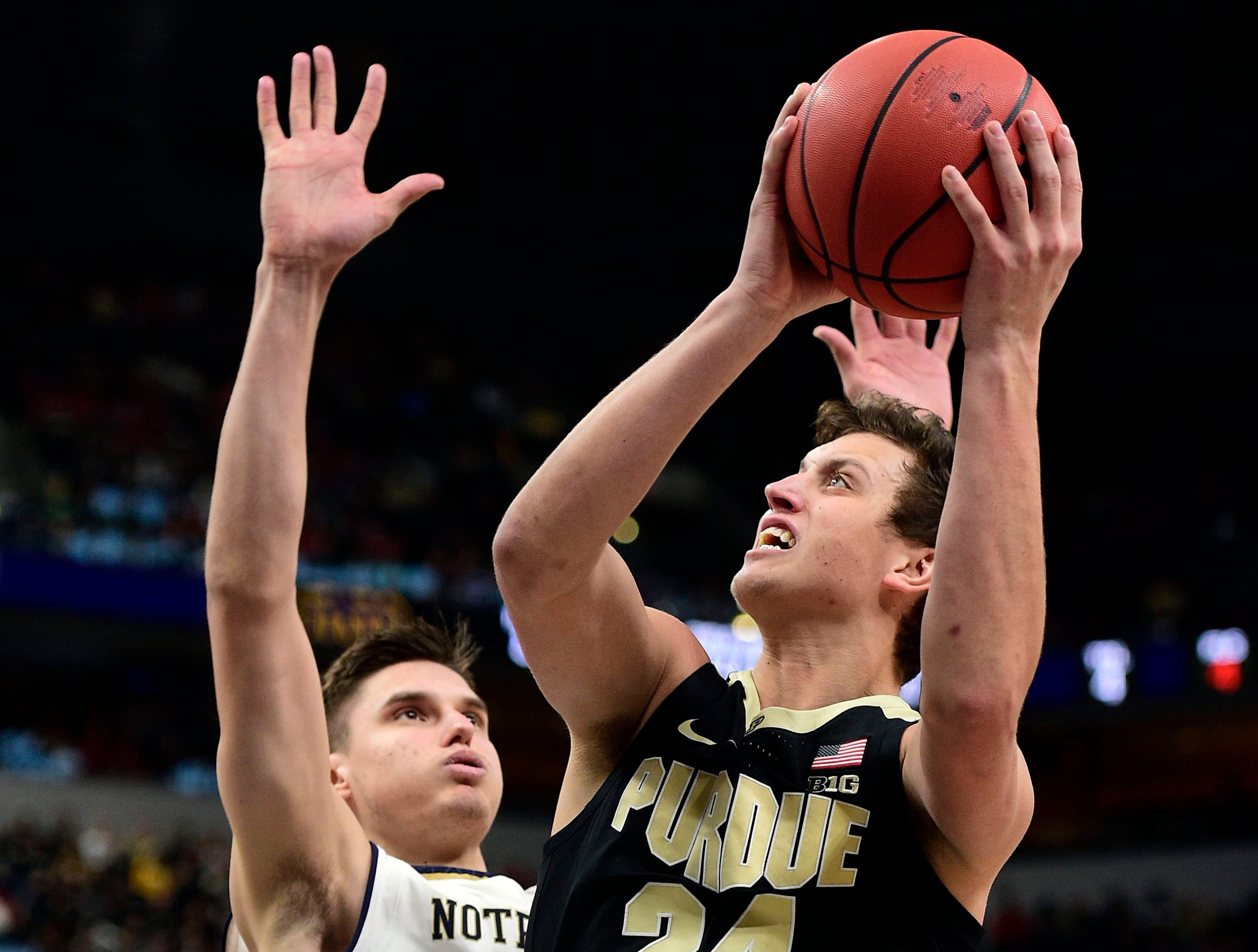 Dec 15, 2018; Indianapolis, IN, USA; Purdue Boilermaker guards Grady Eifert (24) goes past Notre Dame Fighting Irish forward Nate Laszewski (14) at Bankers Life Fieldhouse. Mandatory Credit: Thomas J. Russo-USA TODAY Sports