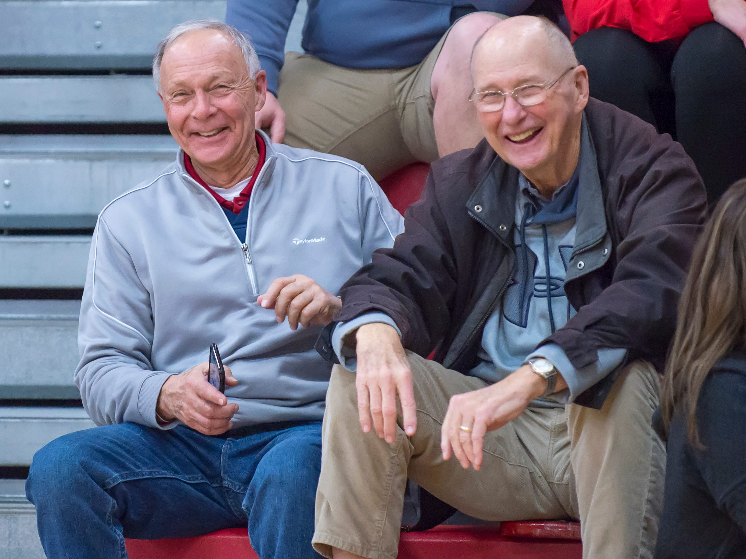The 'veteran duo of Left Troyer and Rick Reeves enjoy the action from the Benton Central at West Lafayette basketball game on December 14, 2018