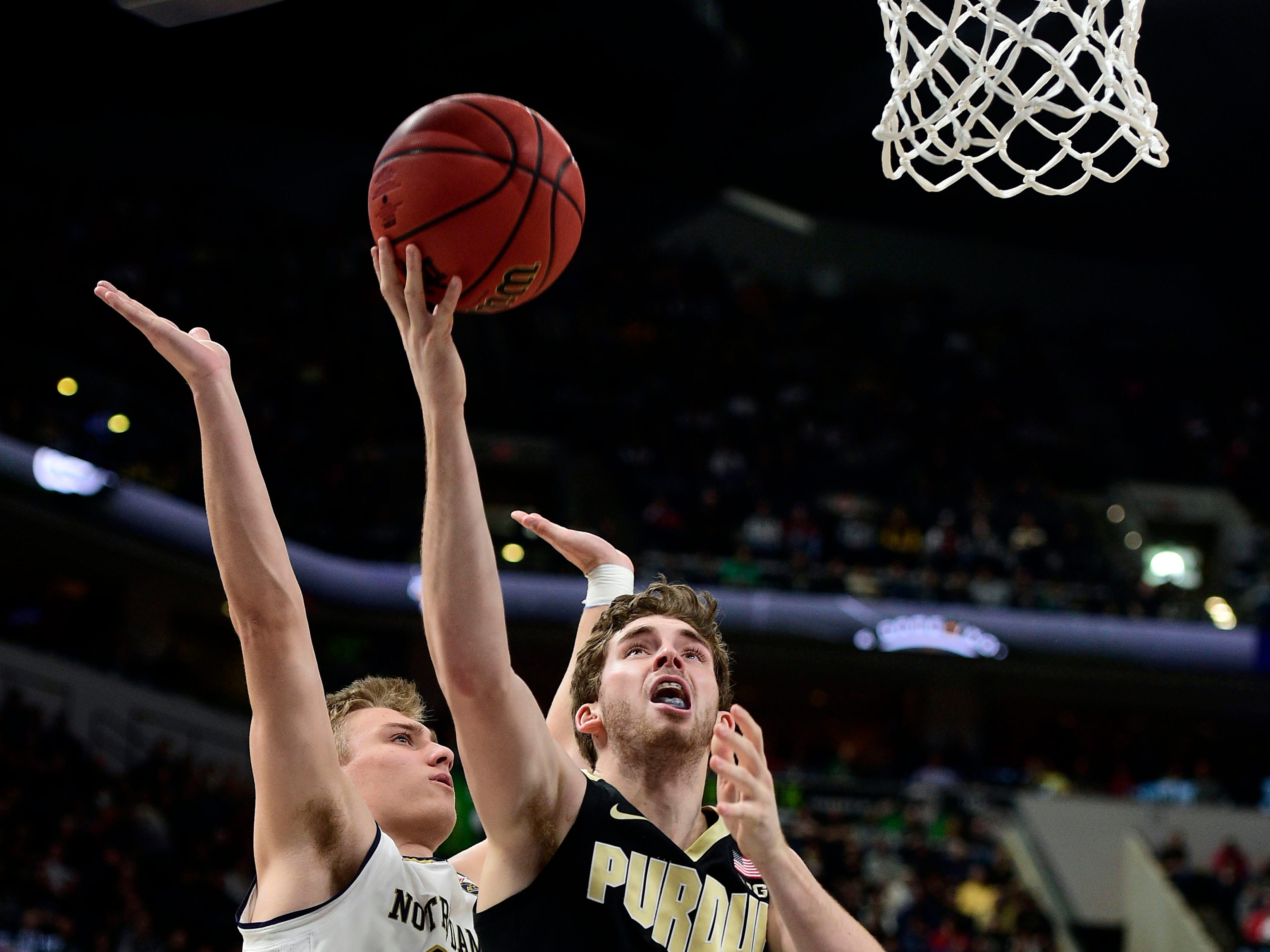Dec 15, 2018; Indianapolis, IN, USA; Purdue Boilermaker forward Ryan Cline (14) shoot against Notre Dame Fighting Irish forward Dane Goodwin (23) at Bankers Life Fieldhouse. Mandatory Credit: Thomas J. Russo-USA TODAY Sports