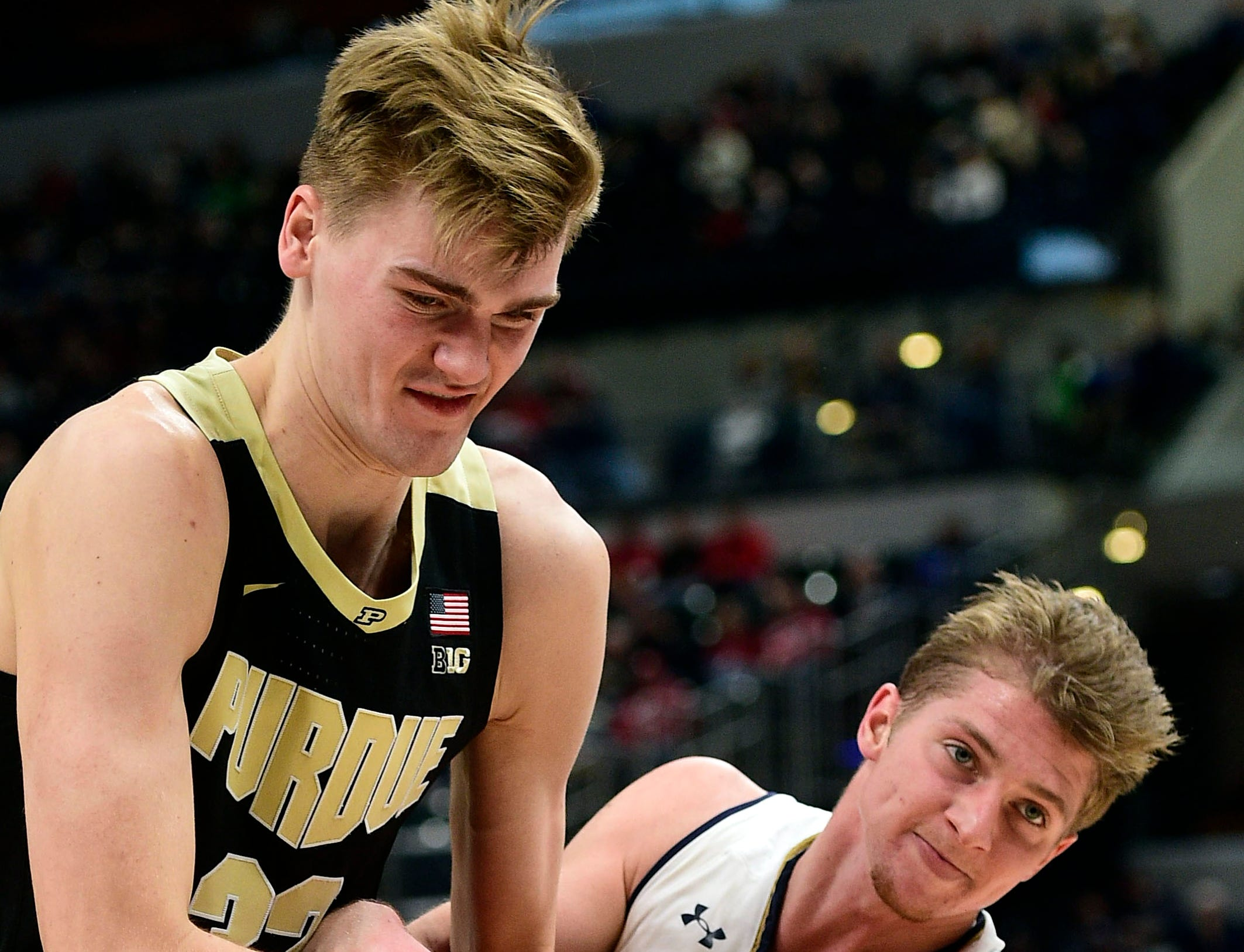 Dec 15, 2018; Indianapolis, IN, USA; Purdue Boilermaker center Matt Haarms (32) and Notre Dame Fighting Irish guard Rex Pflueger (0) battle for a loose ball in the first half at Bankers Life Fieldhouse. Mandatory Credit: Thomas J. Russo-USA TODAY Sports