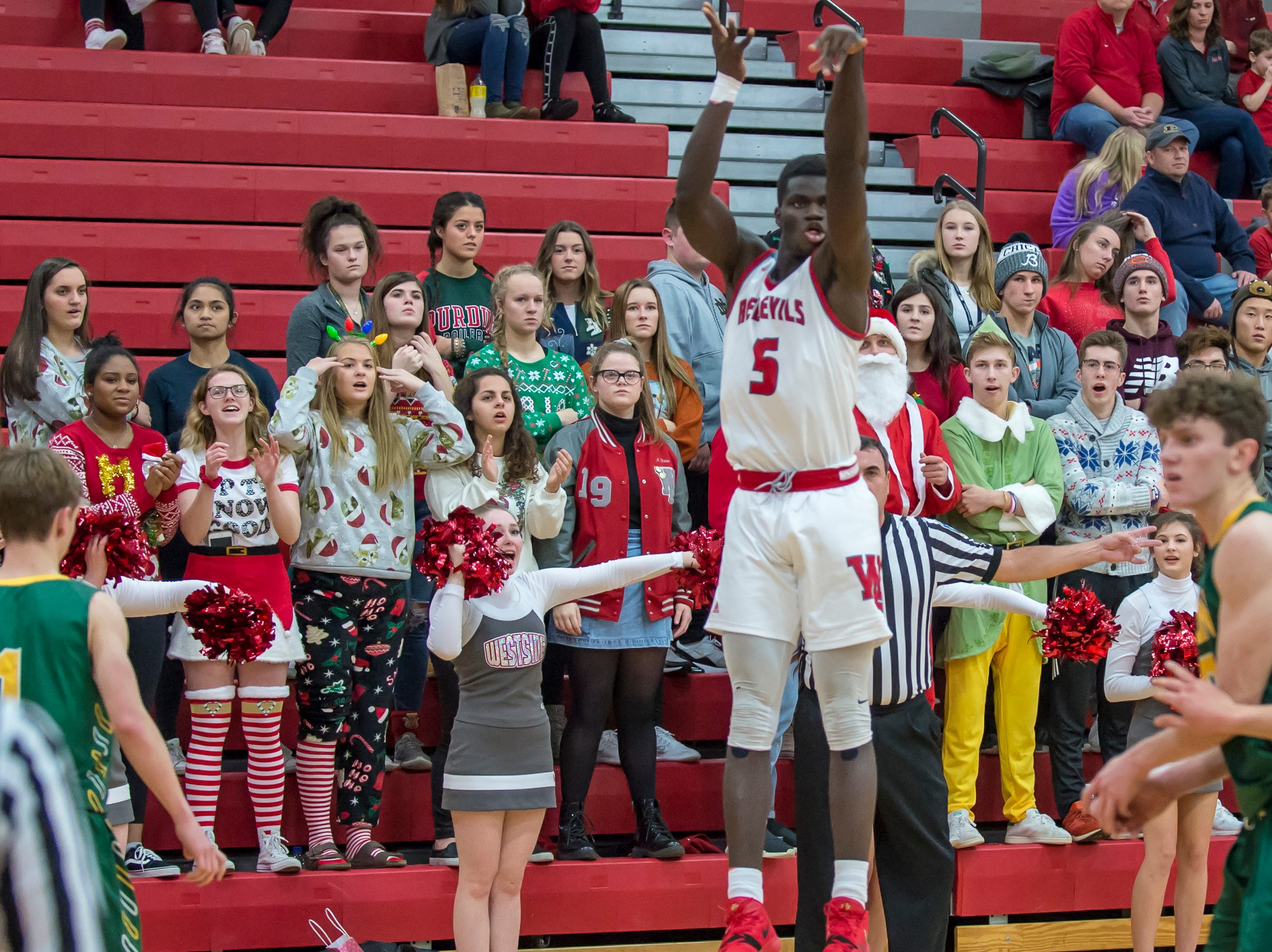 Action from the Benton Central at West Lafayette basketball game on December 14, 2018 - Nelson Mbongo; WL Student section, Santa Claus