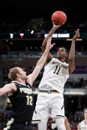 Notre Dame's Juwan Durham (11) shoots over Purdue's Evan Boudreaux (12) during the first half of an NCAA college basketball game, Saturday, Dec. 15, 2018, in Indianapolis.