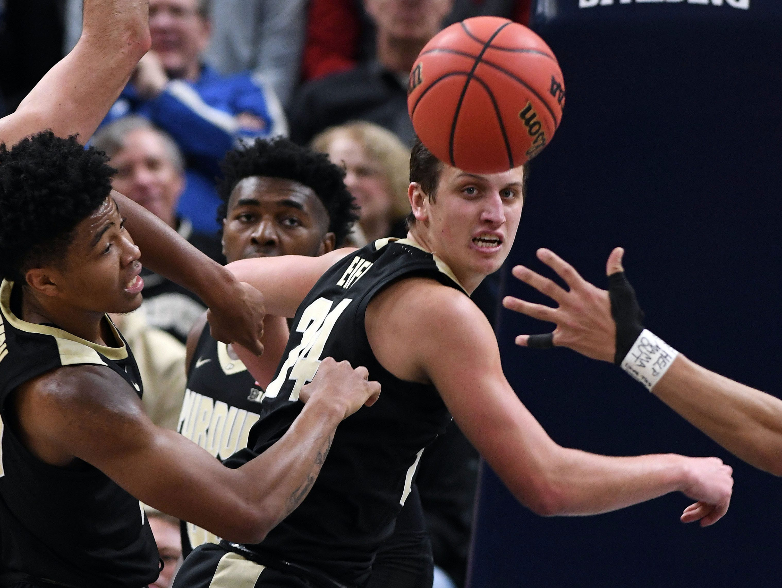 Dec 15, 2018; Indianapolis, IN, USA; Purdue Boilermaker guards Grady Eifert (24) and Nojel Eastern (20) go after a loose ball in the first half against the Notre Dame Fighting Irish at Bankers Life Fieldhouse. Mandatory Credit: Thomas J. Russo-USA TODAY Sports
