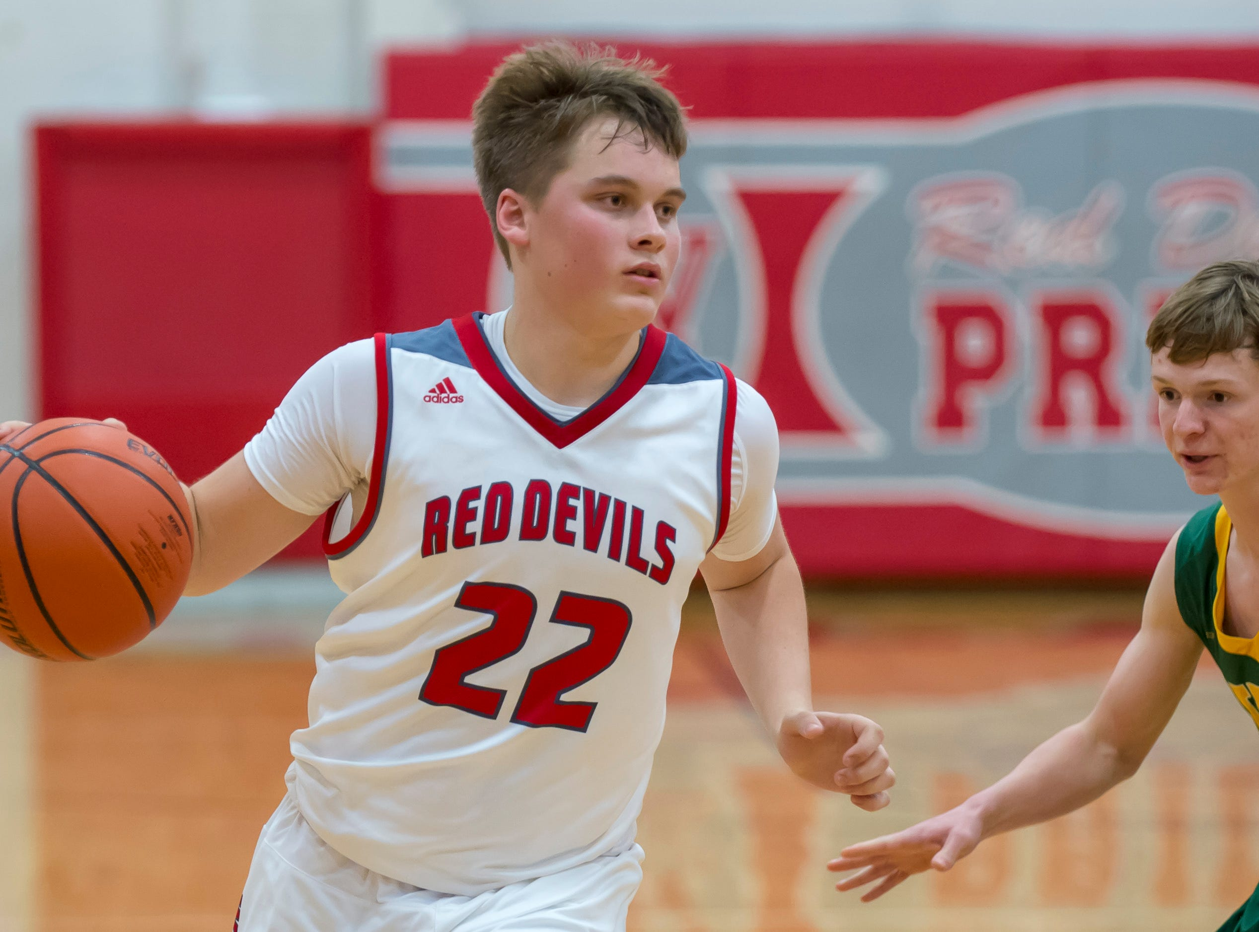 Colin Martin leads the Red Devil offensive down the court early in the Benton Central at West Lafayette basketball game on December 14, 2018