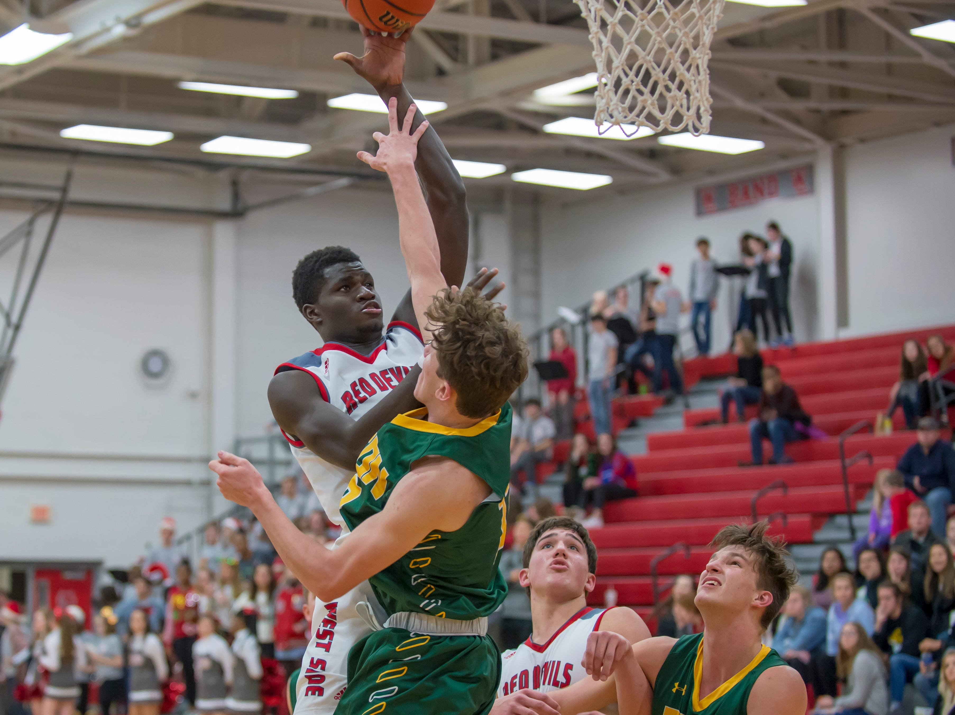 Action from the Benton Central at West Lafayette basketball game on December 14, 2018 - Nelson Mbongo