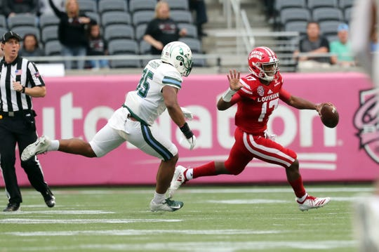 UL backup quarterback Levi Lewis scrambles during UL's Cure Bowl loss to Tulane last Saturday in Orlando.