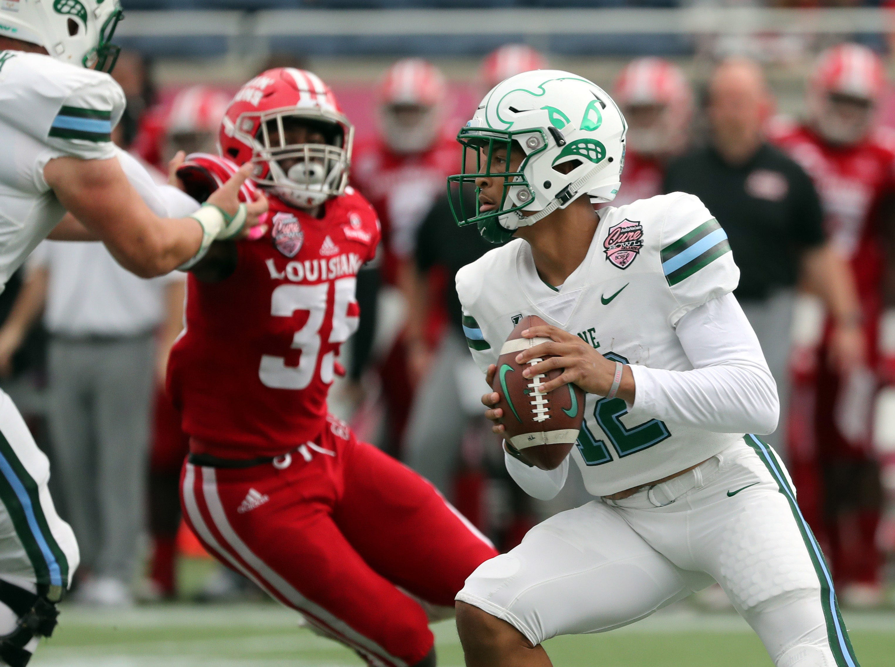 Dec 15, 2018; Orlando, FL, USA; Tulane Green Wave quarterback Justin McMillan (12) prepares to throw the ball against the Louisiana-Lafayette Ragin Cajuns during the first half at Camping World Stadium. Mandatory Credit: Kim Klement-USA TODAY Sports