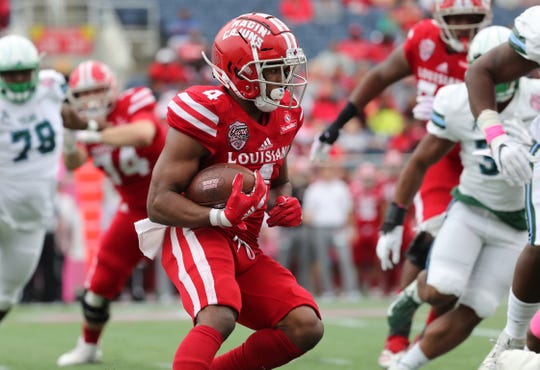 UL running back Raymond Calais rushes against Tulane in the Cure Bowl at Camping World Stadium in Orlando, Florida.