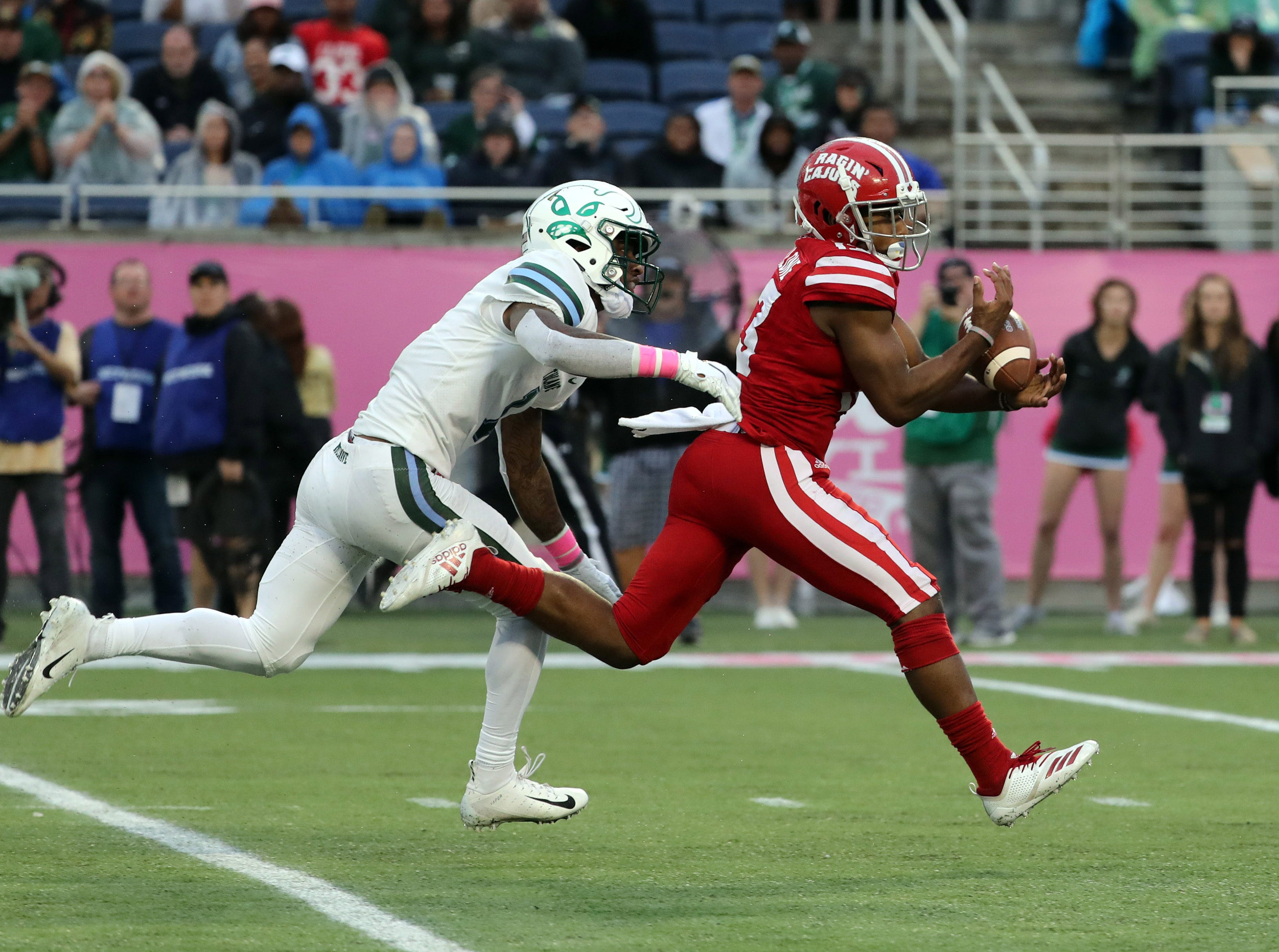 Dec 15, 2018; Orlando, FL, USA; Louisiana-Lafayette Ragin Cajuns wide receiver Ryheem Malone (13) catches the ball over Tulane Green Wave cornerback Donnie Lewis Jr. (1) during the second half at Camping World Stadium. Mandatory Credit: Kim Klement-USA TODAY Sports