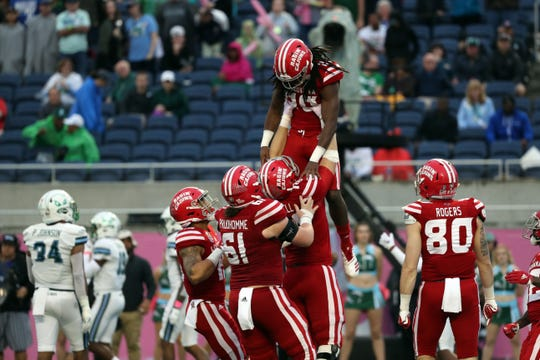 UL receiver Bam Jackson gets a lift after a fourth-quarter touchdown catch in a Cajuns comeback bid that fell short as Tulane won the Cure Bowl 41-24 on Saturday in Orlando.