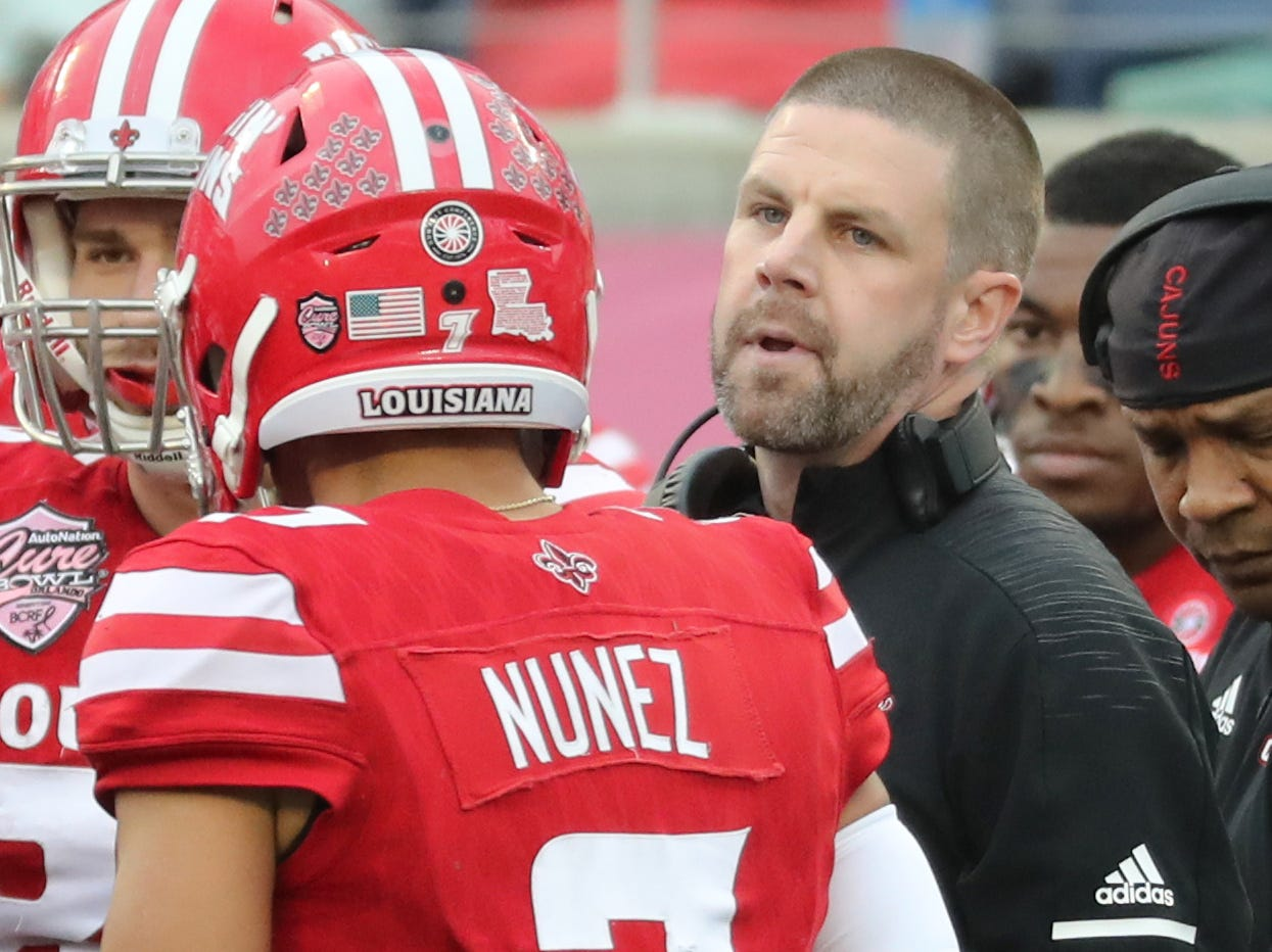 Dec 15, 2018; Orlando, FL, USA;Louisiana-Lafayette Ragin Cajuns head coach Billy Napier talks with quarterback Andre Nunez (7) during the first half at Camping World Stadium. Mandatory Credit: Kim Klement-USA TODAY Sports