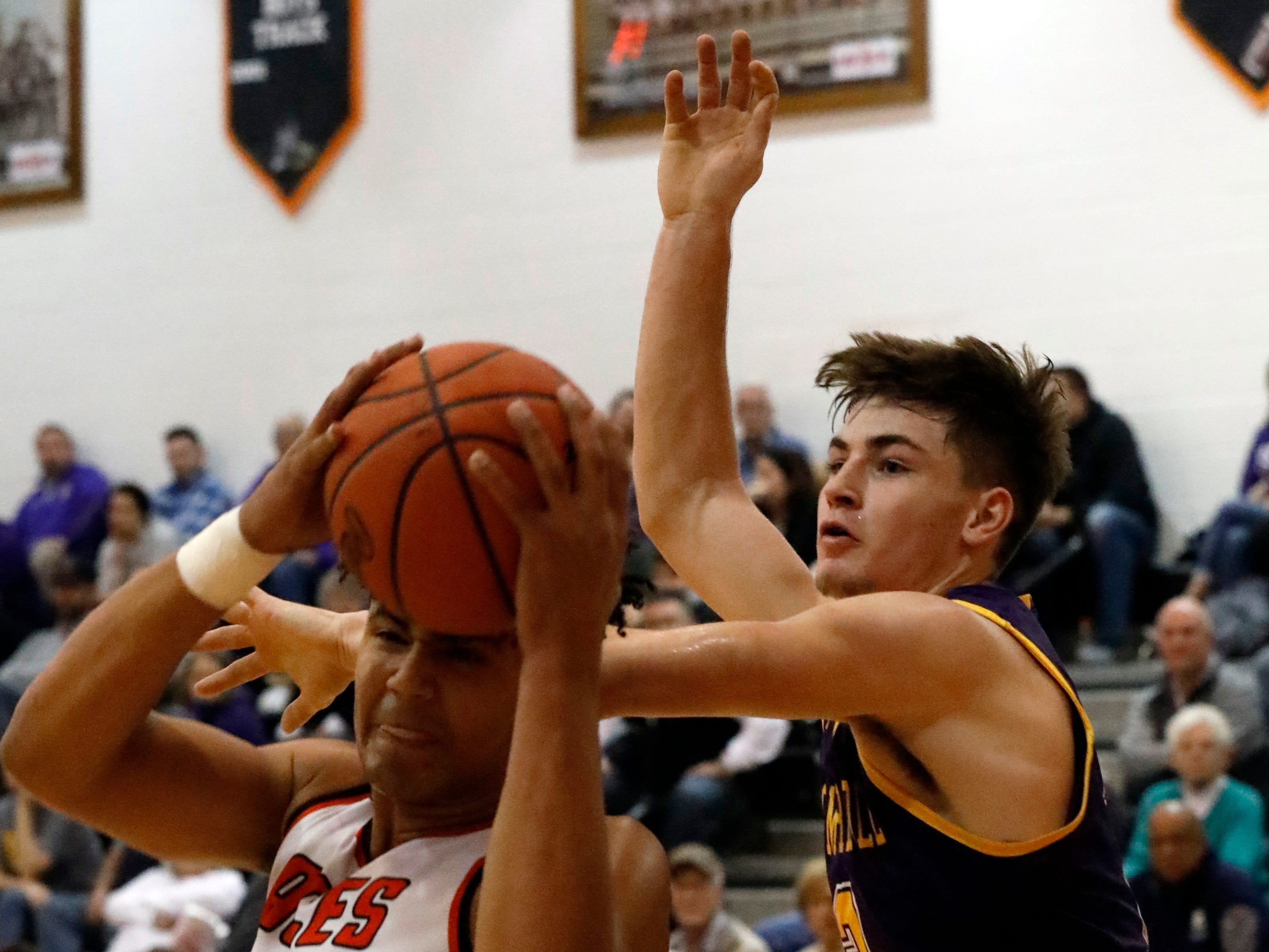Amanda-Clearkcreek's Alex Smith pulls down a rebound as Bloom-Carroll's Otto Kuhns tries to knock the ball away during Friday night's game, Dec. 14, 2018, in Amanda-Clearcreek High School in Amanda.
