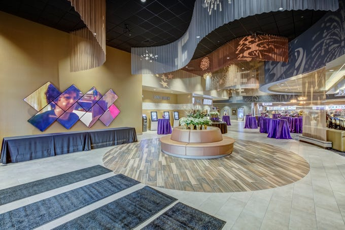 The lobby of Emagine Entertainment's new movie theater Emagine Hartland, shown Friday, Dec. 14, 2018, features a wall of television sets playing movie previews.