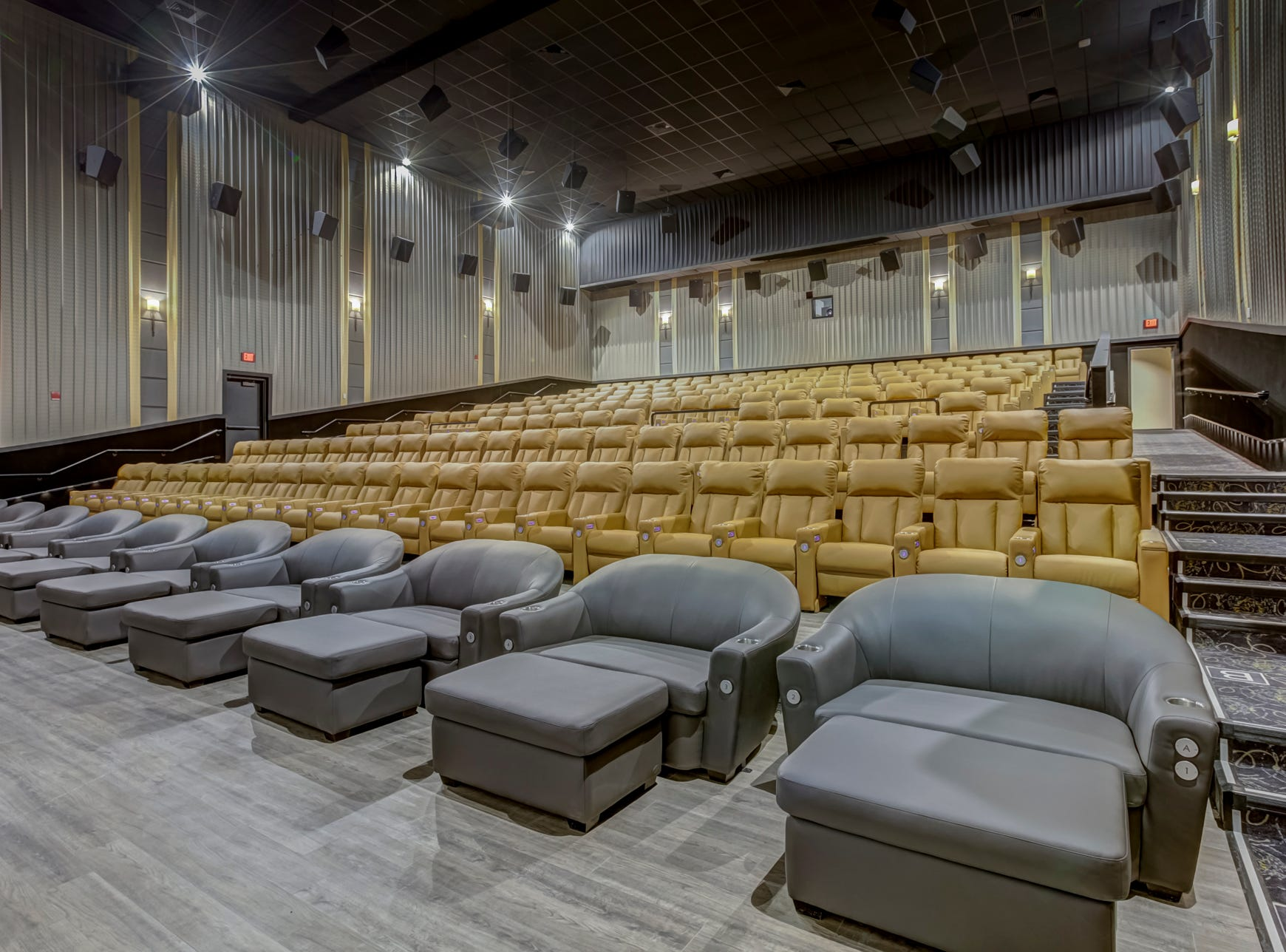 "All 10 theaters at Emagine Entertainment's new movie theater Emagine Hartland feature heated reclining seats and two-seater ""cuddle chairs,"" including the theater's EMAX, shown Friday, Dec. 14, 2018."