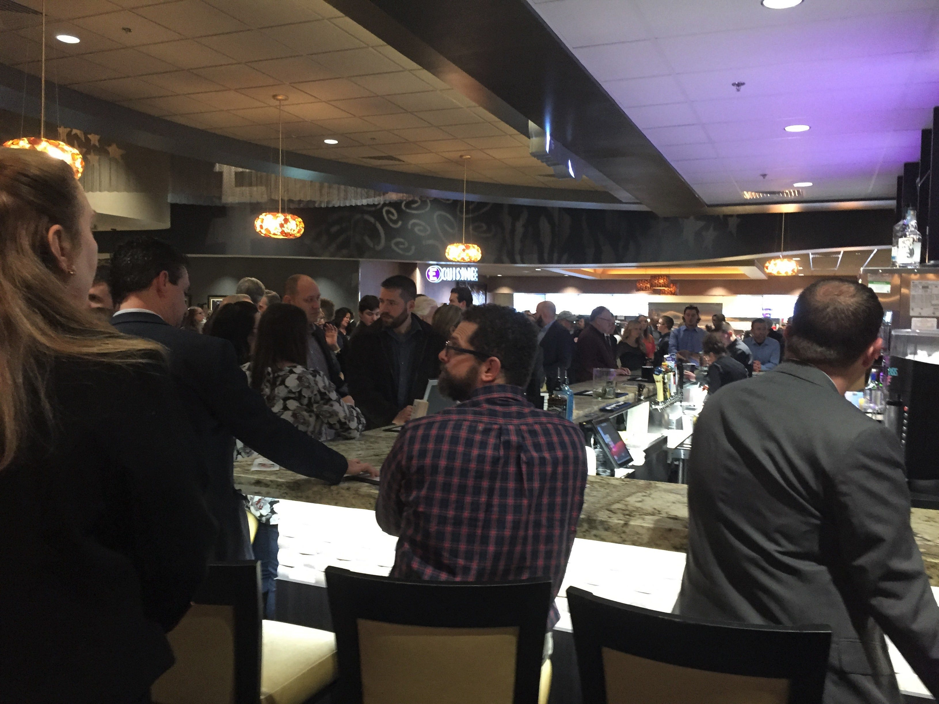 A crowd gathers at the bar at Emagine Entertainment's new movie theater Emagine Hartland at a Friday, Dec. 14, 2018 theater opening charity event.